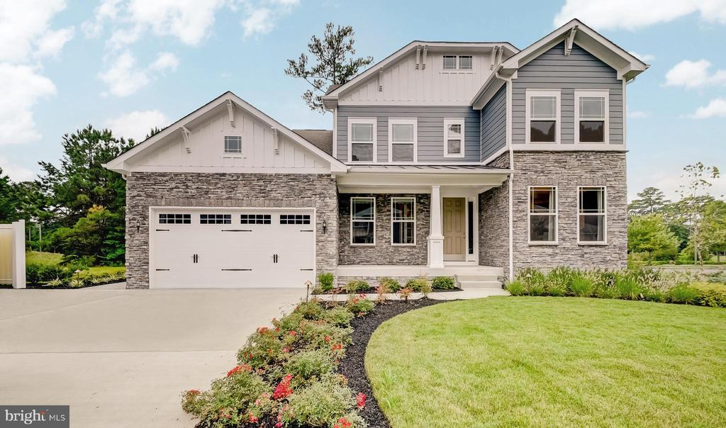 This stunning model home is available now at the popular community of GlenRiddle, located in Berlin, MD. This gated community offers single family homes with wooded or golf course views, two championship golf courses, tennis courts, marina, clubhouse & pool with fitness center only 3 miles from Maryland beaches.