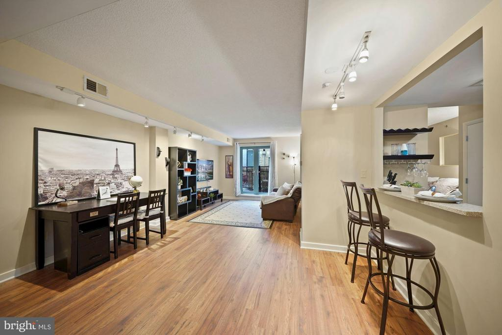 Welcome to 1150 K! An amenity rich building that includes 24 hour concierge, a rooftop deck w/ grills, a fitness room and a billiard room.  One of the largest studios in the city with its own PRIVATE OUTDOOR PATIO.  Conveniently located between Chinatown, Mount Vernon and Shaw. Nearby to George Washington, Howard and Georgetown Universities. Priced under market value and ready to sell.  The gourmet kitchen features granite countertops, stainless steal appliances  and has space for two at the breakfast bar.  This unit also features an in unit washer and dryer. Parking is also available for rent.  Don't wait to come and see this wonderful condo in the heart of the city!