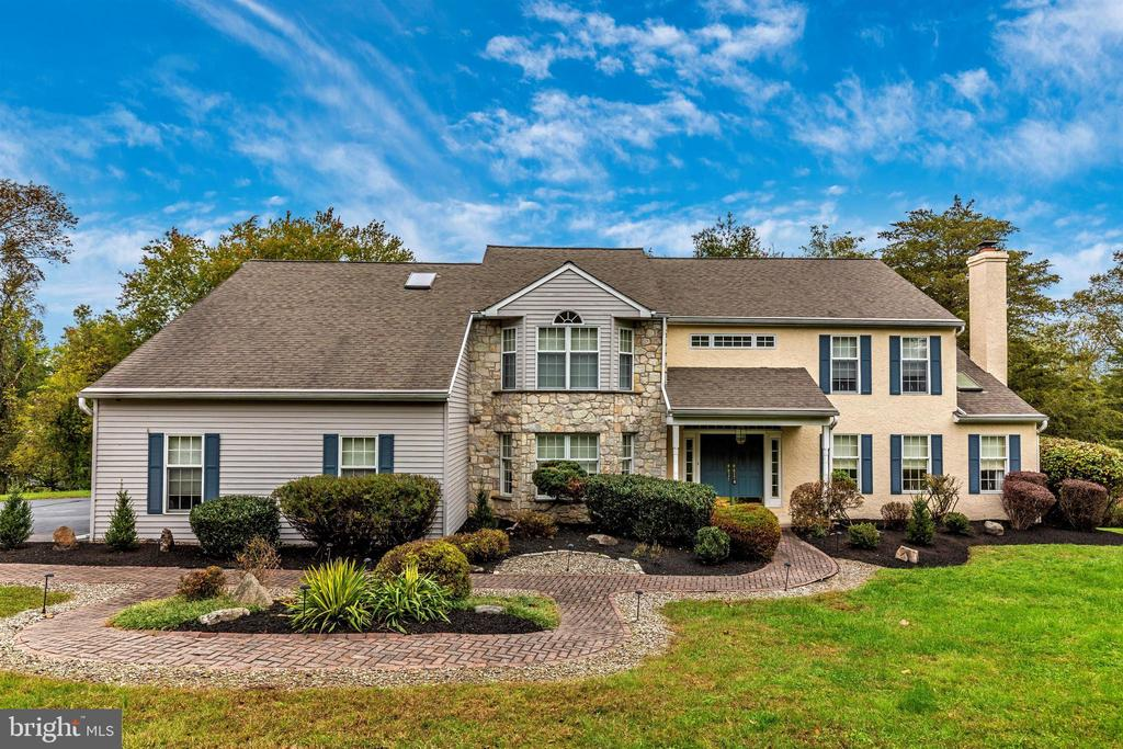 This beautiful custom home with over 5,000 square feet of living space, is situated on 2.3 acres of a premium, semi-secluded, scenic countryside in Chester County. The professional landscaping compliments the picturesque view of the exterior face of this classic home.  As you enter the home, the large foyer presents a beautiful preview of the master craftsmanship that is evident throughout the home.  To the left of the foyer is an office fit for an executive with beautiful built-in book cases. To the right of the foyer, an inviting formal living room, equipped with a wood burning fireplace, crown molding, hardwood floors is the perfect place for gathering on a crisp fall evening.   The natural flow from the living room brings you to the  dining room,  complete with crown molding and authentic hardwood floors. Off of the dining room, a quaint deck offers gorgeous views  of the back yard.    The eat in kitchen boasts hardwood floors, granite countertops, double oven, recessed lighting, and a granite island with built in cooktop.  The large floor to ceiling stone fireplace is the focal point in the expansive family room. Ample windows and double doors leading to a custom deck complete with stairs leading to the private driveway. The 3 car  garage provides ample space for vehicles along with extra storage space.  The sunroom is the perfect setting to gather with family and relax watching the sun set in the evening.  The second floor contains 4  generously sized  bedrooms with a full open hallway that overlooks the stunning family room on the first level.  At the end of the hallway you will find your lovely master bedroom suite with a sitting room, his and her walk-in closets, and  bathroom with a large step up soaking tub, stand up shower, and vanity.   The location of this home is in close proximity to historical Valley Forge National Park. This home is the perfect combination of traditional elegance with custom finishing touches.