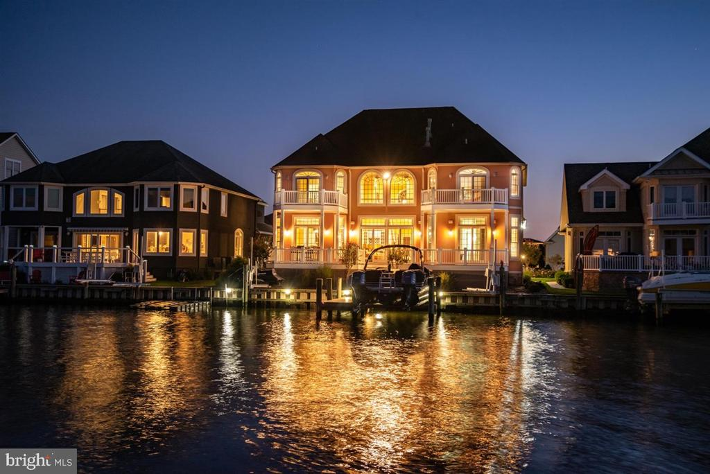 Exquisite one-of-a-kind custom 6BR/5.5BA waterfront estate in Ocean City, Maryland hits the market!  Immerse yourself in the ambience of this luxurious waterfront lifestyle while enjoying breathtaking views of the water and enchanting bird sanctuary. This property features exceptional craftsmanship with astute attention to detail. This home is built for the sophisticated buyer looking for custom finishes, efficiency and a touch of class. This home is constructed with state of the art Insulated Concrete Foam with 12 inch exterior walls and hurricane construction, including coastal grade windows and doors. This home has plenty of space for family and friends featuring five spacious bedrooms with five master suites. The  second floor sixth bedroom could be a large home office perfect for the remote worker in today's world. The first floor master bedroom overlooks the water and is fit for a king and queen with a gas fireplace and luxurious custom bath overlooking the water, and you can enjoy morning coffee on the water front deck adjoining the master bedroom. The incredible kitchen is sure to delight the chef in your family.  It features quartz countertops, two sinks, Viking appliances, upgraded cabinets, breakfast bar, eat in kitchen and many other upgrades.  The dining area is off the kitchen and overlooks the water.  The family room is off the dining room and also overlooks the water. The family room has soaring 22 foot ceilings and another gas fireplace. In total there are three gas fireplaces in this beautiful home making it the perfect place for year-round enjoyment.  There is a sunroom with a fireplace off the front of the house which could also be used as a separate dining room or second home office if you prefer.  Additional features in this waterfront estate include Brazilian cherry hardwood floors, eight separately heated tile floors with programmable thermostats, custom window treatments, two zone heating system, two zone Manabloc plumbing system with 2 Rinn