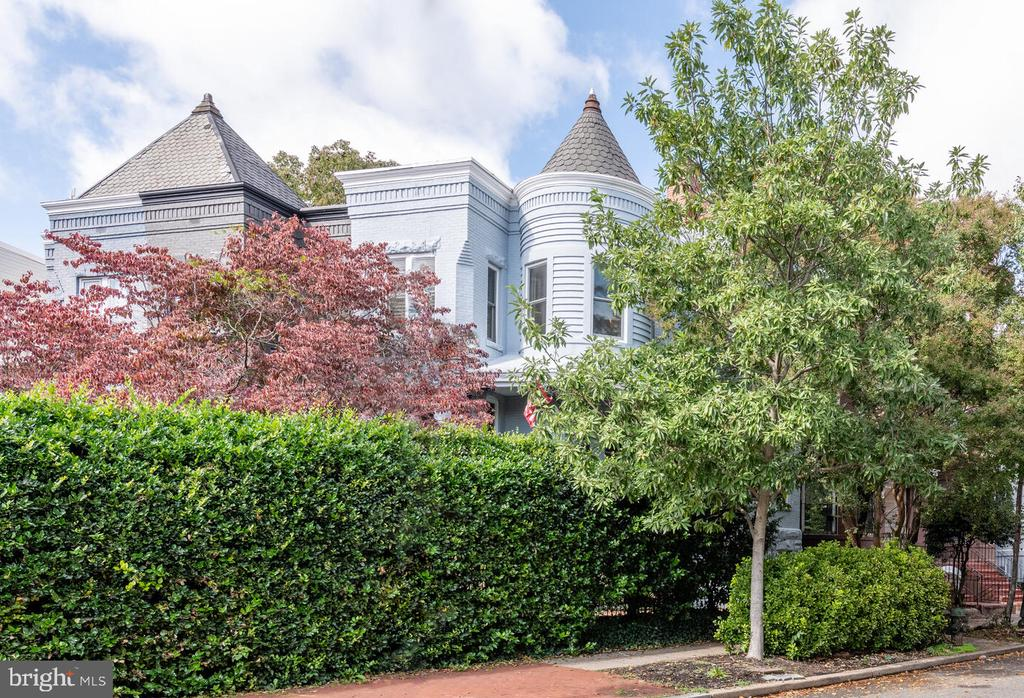 Quintessential Capitol Hill gem is a must see! This beautiful turreted Victorian with prominent facade and expansive wrap around porch is uniquely situated to overlook Folger Park from a corner lot with southern and eastern exposure. This home is a perfect blend of old world charm and elegant modern updates, including beautifully renovated kitchen and baths, newly refinished hardwood floors, new windows, skylight, and wood burning fireplace. Upstairs, three full size bedrooms include an amazing owner's suite large enough for a king bed and an additional sitting area that overlooks the park. Fully finished basement apartment with CO offers the perfect separate suite for visitors, an au pair, or a significant rental income stream. Huge outdoor patio is beautifully landscaped with high surrounding privacy hedge for truly private outdoor living and entertaining. Prime location just around the corner from Cap South metro and just blocks from the U.S. Capitol, Supreme Court and Library of Congress. This location is a walker's dream. Shop at Whole Foods, Trader Joe's, Yes! Organic or historic Eastern Market, or stroll to multiple restaurants and bars along Barracks Row. Catch a game at Salt Line down by Nats Park or even make your way to The Wharf! Street parking is easy, but why would you leave?