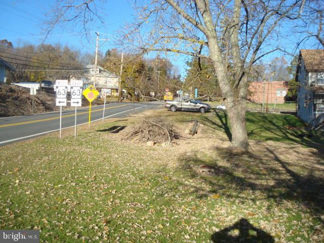Corner lot at Rt. 63 and Upper Ridge Rd. Public sewer available. Has residential and business possibilities. Contact Green Lane Borough Zoning Officer for details.