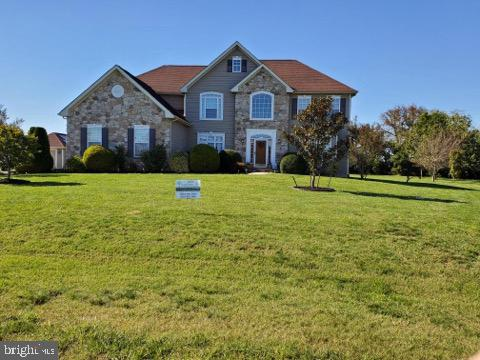 """This Beautiful one of a kind 5000+ s/f, 6BD, 4.5BA, 4-car garage, custom built home with stone front elevation sitting on 1+ acre. This Home boasts a bright open floor plan, NEW hardwood floors, gourmet eat-in kitchen with large granite counters, stainless appliances, 44"""" hi-boy cabinets, and up-scale custom lighting. Add to that the Wired BOSE whole house music and surround system powered by 14 in home BOSE speakers with individual room control.  The attractive Floor to ceiling stone/brick gas fireplace will have you longing for quiet winter nights.  This home was well designed with a master bedroom on each level with the second floor master bedroom with complete En-Suite master bath and extended sitting room.  a 20x15 trex deck off the back with a 14x28 Amish built Garage just off the driveway, fully finished walk out basement with an additional bedroom and full bath.  Add to all this space and style a solar package virtually eliminating the high electric bills. This home is in a lovely community just 2 minutes from the new Bayhealth hospital and just minutes to all of your favorite beaches.  This large executive home was built for comfort and style."""
