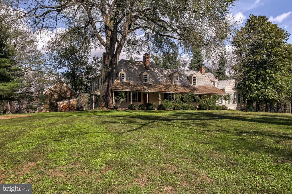 A stunning historic property in the heart of the Caves Valley; 26+ acres of privacy; a gracious 18th century 5 bedroom/4 full bath clapboard and cedar shake home meticulously restored in the 1970s; distinguished stone outbuildings that date from the 18thc when this was a tobacco farm that included a barn, carriage house with tobacco loft, tenants' quarters, and smokehouse.   Truly one-of-a-kind surrounded by protected properties on all sides, yet minutes from all the shopping conveniences.  Shown by appointment only.  Buyers' agent should schedule all appointments through Showing Time.
