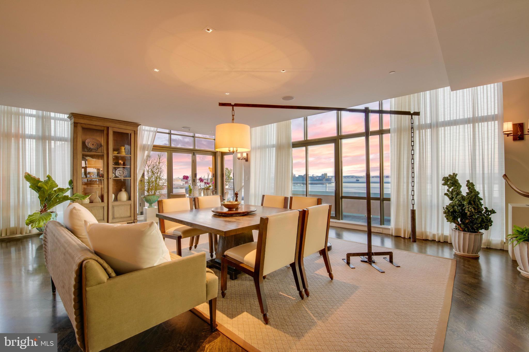 For those seeking modern luxury, elegance and comfort, this waterfront penthouse in Canton Cove provides nearly 5,000 square feet of impeccably designed living space. Overlooking Baltimore's Inner Harbor, the property boasts a wrap-around terrace with southern, eastern, and western exposures for beautiful sunrises and sunsets, and ample natural light throughout the day.  In 2008, the property was thoughtfully re-designed by esteemed architect Bobby McAlpine to maximize views, and fully renovated with high-end finishes, appliances, and systems. The open floorplan lends itself to both entertaining and everyday living, with easy separation if needed.  Adjacent to Canton Waterfront Park and minutes to Canton Crossing and a multitude of restaurants and shops, the walkability of this property is unmatched. Enjoy the Baltimore Waterfront Promenade, easy access to marinas, and proximity to Fells Point and Harbor East.  Notable features of the property include floor-to-ceiling windows, spectacular views, and terrace access from nearly every room, cove lighting, custom closets, window treatments & built-ins, a Bravas Smart Home Automation System that controls audio/visual, lighting and thermostat from your phone, a built-in bar and a butler's pantry, chef's kitchen with Viking & Wolf appliances,  two gas fireplaces, two sets of washer/dryer, beautiful marble baths with custom tile work.  * The property is being sold furnished, with high-end, custom furniture pieces. Please contact listing agent for detailed list.