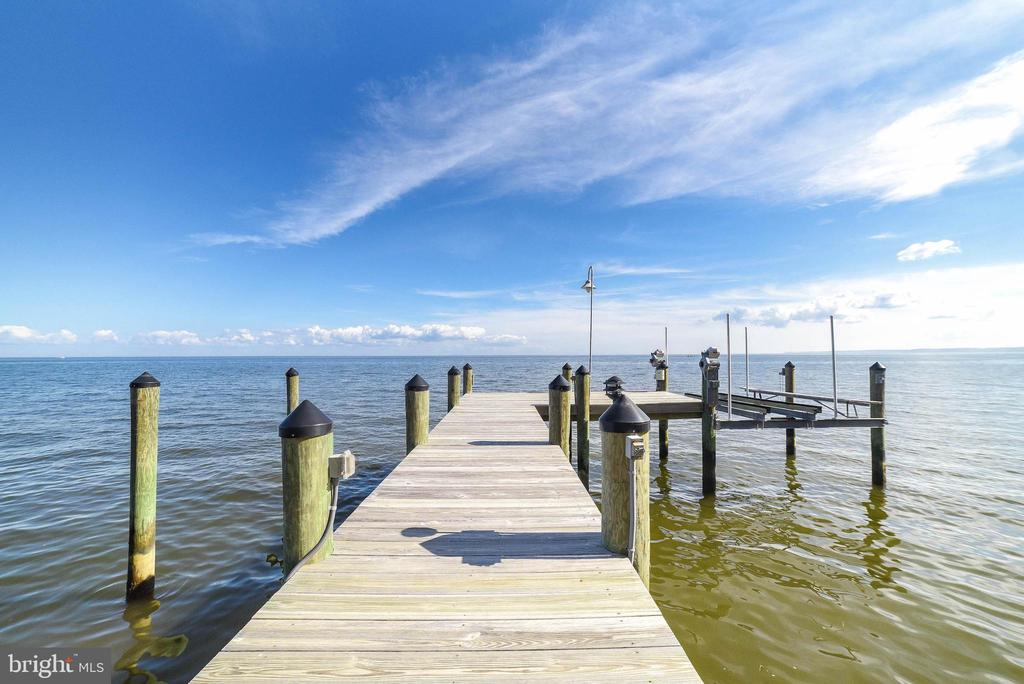 Chesapeake Bayfront with unbelievable views!! Crab and fish from your own pier, right at your doorstep.  Minutes to schools, shopping, restaurant, hospital, yet quiet and tucked away.   The original home on this amazing site was removed and this gorgeous home, full of architectural detail and high end finishes, was built in 2015.  The unstoppable Bay views and amazing sunrises will make working from home and self distancing a pleasure!! Open kitchen with Viking stove, Bosch dishwasher, commercial refrigerator, open shelving, and huge island allows you to be the gourmet chef while enjoying a fire burning in the fireplace. Inviting, spacious, open living and dining space with wrap around bay front deck. 6 sliders off Great Room to the deck,  10' shiplap ceilings on ML, 9' ceilings on upper level.  Custom milled white oak flooring throughout.  All cabinetry is custom built by Amish craftsman. Plantation shutters. Custom made iron railings throughout . Solid wood closet doors.  Bayfront Master suite with custom bath and walk in closet will delight the most sophisticated of Buyers.  Also a Bayfront  office or fourth bedroom.  2nd Master with it's own full bath.  Laundry Room with custom built ins on upper level.     Rip rap, bulkhead and pier with 14,000 lb boat lift add to this perfect lifestyle.