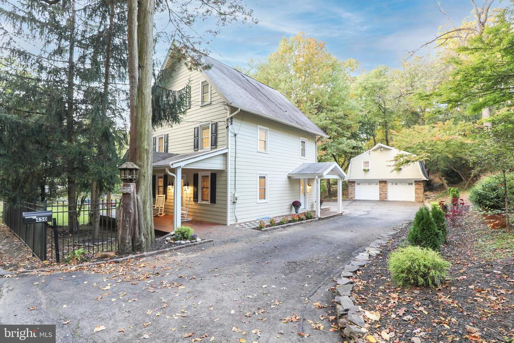 This historic farmhouse in Radnor includes a 1 bedroom, 1 bath in-law suite above the detached garage. The main house has been beautifully renovated both inside and out with Hardie Plank siding, and features 4 bedrooms, 2 1/2 bathrooms. Reminders of its c.1875 heritage remain in the details, while the redesigned interior blends easily with today's lifestyle. A crisp color palette was chosen to highlight the pegged wood floors that run throughout most of the main level, including a separate dining room. Large windows and recessed lighting brighten the cook's kitchen with granite counters, subway tile backsplash, lots of white cabinets and storage, and stainless steel appliances. Open to the great room, where a picture window provides wooded views and a stacked stone fireplace with raised hearth and hefty wood mantel. Sliding glass doors open to the 2nd story deck where panoramic views of the countryside may be enjoyed. A powder room completes the main level. Upstairs, 3 nicely sized bedroom share the updated full bathroom located in the hallway. The third level provides a spacious main bedroom suite with plenty of closet space and an updated bathroom. Plenty of parking, in addition to an oversized 2-car garage. Upstairs, the studio apartment was nicely updated and certainly a rare find in Radnor. Beautiful views from the large windows in the living area with vaulted ceiling and exposed beams, or outside on the expansive deck. Take advantage of this great opportunity while it is available!