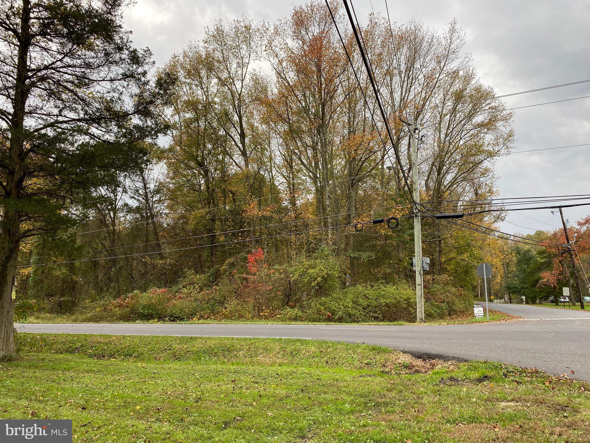 This is a unique opportunity to rebuild this home on its present footprint.  Corner location includes both lots Block 14, lot 15 and Block 14, lot 14 combined to be approximately 2.25 acres.  You will have to check out all requirements and testing on your own.  Buyer should satisfy themselves as to the viability of this lot.   See if this will work for your plans?