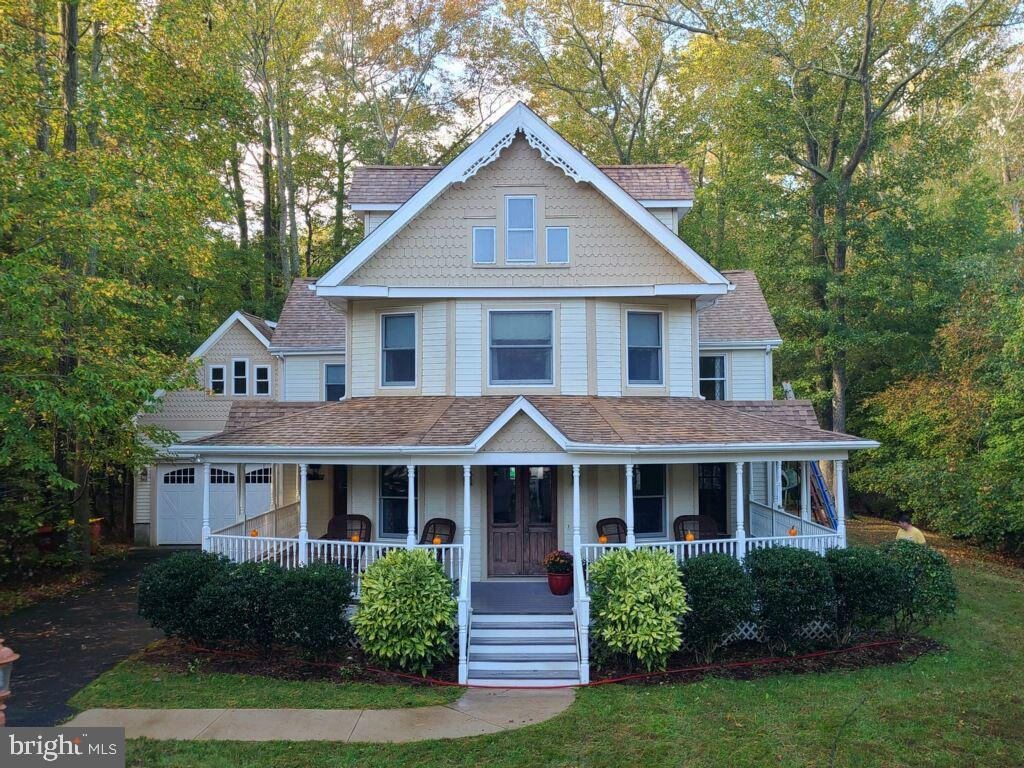 Just minutes from Bethany Beach, this stunning Victorian home is as stately as it is warm and comfortable, with all the quality and custom upgrades you expect in a fully renovated yet historically preserved, prize property. Beautifully remodeled, many of its original features are highlighted, both on the exterior trim and throughout the space, including the gorgeous front door greeting you on the wide, wraparound front porch. The kitchen area has been updated with cabinetry, a coat closet and pantry, appliances, desk space, an abundance of counter space and a large center island, perfect for cooking and entertaining. See if you can locate the charming back stairway behind a door in the kitchen that leads up to the second floor. Next you will find a sun-filled family/dining room with a custom built-in china cabinet and plenty of room to read or watch TV in the evenings. Off the family room you will discover the formal living area, great for entertaining or relaxing (note the home office nook in the corner), a beautiful gas fireplace with the original mantel, and the original, decorative staircase and railings. Upstairs are 2 sizable guest bedrooms, a recently remodeled guest bath, and a large, primary bedroom that extends across the full length of the house front, with a walk-in closet and its own private bath. Locate the entry point of the back stairway and find another set of stairs leading to the wonderful attic space with 3 separate rooms, ready to be finished out as a 4th bedroom, children's play area or home office. The backyard is like an oasis with an oversized deck, a large, screened gazebo with electricity, and plenty of yard space for entertaining. The garage offers an oversized space for one car with lots of storage and a full stairway leading to a large, unfinished room perfect for more storage, in-law suite, game room, or home office. The house is conveniently located, minutes away from grocery shopping, restaurants, and other conveniences, not to menti