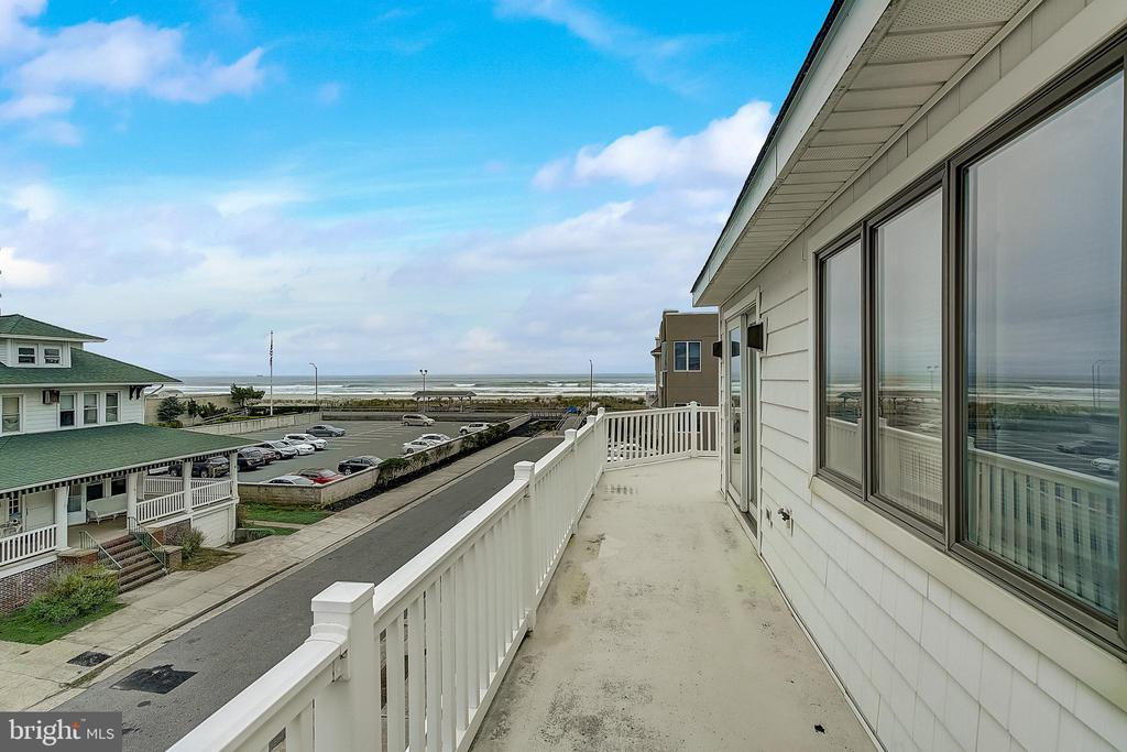 Three levels of spacious living with Ocean and Beach views from almost every room. The Lower level of the home features a spacious bonus room that can be used as a bedroom, office, or game room with a stone wood burning fireplace and tile flooring. The home also features a full bath and kitchenette. The second level offers a living room with a stone wood burning fireplace, dining room, eat-in kitchen with granite countertops and Center Island all complete with tile flooring. The third level of home features three bedrooms and 2 full baths. Special attributes of the home include 2 outside showers and a 2 car attached garage with remote opener and 3 off street parking spots. Hurry, own a piece of paradise while interest rates are at all-time lows.