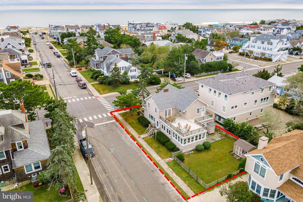 Located in the desirable Little Egg Harbor Yacht Club neighborhood, on the corner of Belvoir and Beach Ave, one short block to the beach and two blocks to the bay. This 5 bedroom 2 bath home features a family room on both the first and second floors. Large dining room open to the kitchen area, leading to a comfortable charming sun porch. There is a large deck on the second floor to watch beautiful sunset views and a great front first floor deck, which is perfect for morning coffee or just to enjoy the peaceful serenity of this fabulous neighborhood!  Just a quick bike ride or walk to shopping, restaurants, playground and entertainment.