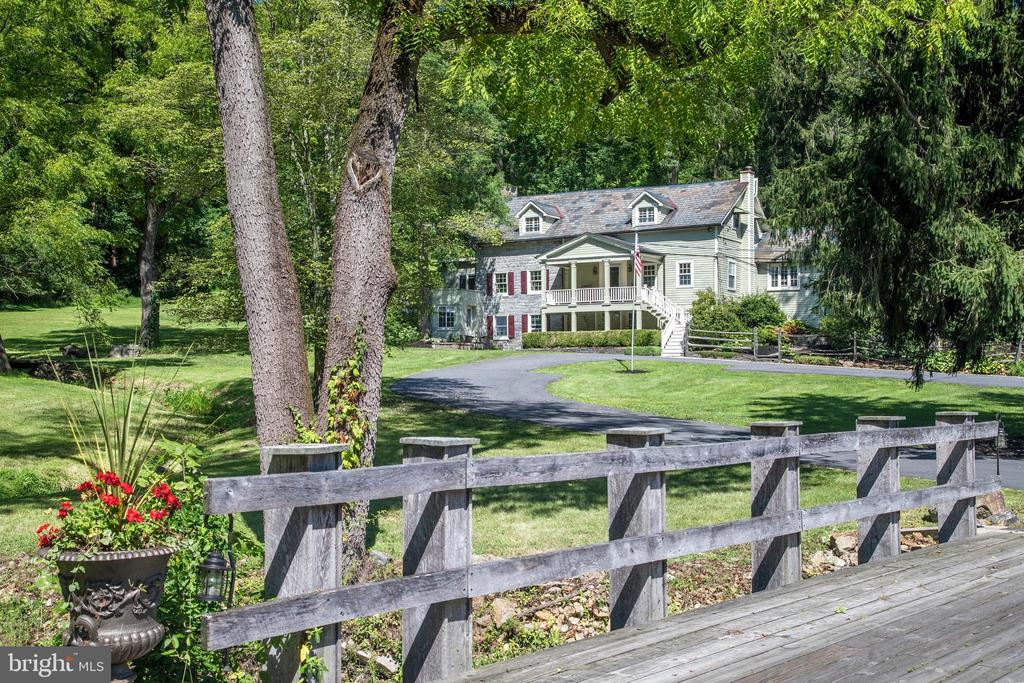 Set off the road and encompassed by 47 acres of woods and open space.