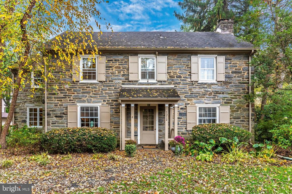 Welcome to the classic Main Line beauty you've been waiting for! This picturesque stone colonial is located on one of the prettiest streets in Lower Merion. Charm and character abound in this wonderful home!  Enter the center hall colonial with hardwood floors throughout.  The living room features a beautiful fireplace, deep windowsills, crown molding, and french doors to the family room.  The spacious dining room, perfect for hosting life's biggest moments,  features a wonderful arched built-in corner cabinet and chair rail.  The center hall leads you to the eat-in kitchen with counter seating and a breakfast room. The door leads to the attached 2 car garage.  The light-filled great room just off the kitchen features a valued ceiling, skylight,  coat closet, and wonderful built-in cabinetry.  The wall of windows overlooks the private level .33 acre lot.  The french door from this room leads to the flagstone patio. The second-floor Main bedroom has hardwood floors, two closets, and an updated full bath.  The next bedroom is ensuite with an updated full bath, freshly painted, and new hardwood floors.  The second and third bedrooms are both spacious with good closet space and newly finished hardwood floors and freshly painted.   The hall bath has also been updated and the second-floor hallway has been newly painted.  The walk-up attic is the length of the home holds endless possibilities for its use!   The finished lower level is perfect for a play area,  gym, office, take your pick!  French drain, updated gas heat, and newer hot water heater are just some of the features of this lovingly maintained home.  The beautiful lot is a private oasis with a wonderful space for outdoor fun.  The location can not be beat.  Short walk to playgrounds, tennis courts, and fields at South Ardmore Park.  Close to Suburban Square shopping and dining and Amtrak with a direct train to NYC and an easy commute to Center City all in Award Winning Lower Merion Schools.  Don't miss the chanc