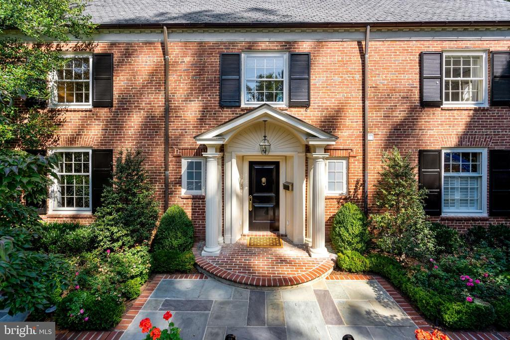 Terrific Georgian Colonial  with beautiful pool and great indoor outdoor interaction with the lovely professionally landscaped garden--numerous bedrooms along with a spacious studio or office (with half bath) with vaulted ceiling over the two car garage.   Room for everyone. Fabulous master suite and multiple family rooms.  Lower level has wine cellar,  movie room, play room and au pair suite.