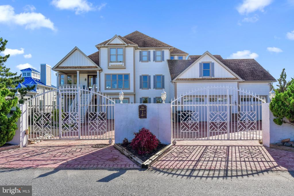 Rare Opportunity to Own one of the Finest Southern Bay and Ocean Views Homes available in West Ocean City. This Spectacular 6 Bedroom, 6300 Square Foot Coastal Waterfront Masterpiece  is Situated on a Deep Water Bulkhead within eyesight  of the Atlantic Ocean and Inlet and Will Accommodate Deepwater Dockage for up to an 80' Sport Fishing  Yacht. Grand Open Vistas of the  Bay, Ocean and Assategue are Truly Stunning and Available from All 3 Levels of this Magnificent Coastal Home.  This Wonderful Home Boosts  a 4 Car Garage and an Elevator to Service All 3 Levels.  The Second Floor is the Main Living Area Offering Commanding Waterfront Views of the Bay, Ocean, Assateague and Commercial Harbor, The Spacious Kitchen has  New Stainless Steel Appliances, Butlers Pantry, Abundant Cabinets, Granite Counter Tops, Island and Eat-in Area facing the Open Bay and is a Great Gathering area that Leads out to the Southern Exposed Waterfront Decks,  There is also a Formal Dinning Room, Great Room with Vaulted Ceilings, Billiard & Game Room and Super Bay Front Master Suite & Bath as well. Third Floor has another Master Suite With Southern Coastal Views  from the  rear Large Deck.  Additionally, there are 2 more Bedrooms on the 3rd Floor that are serviced by a Jack & Jill Bath. This First Floor has 2 More Bedrooms, a second Kitchen and Living Area and access to Multiple Garages and Rear Covered Waterfront Patio, This Waterfront Home has many unique Features including 2 Huge Laundry Rooms on separate levels, Plenty of Storage Closets, Workshop, 3 Natural Gas Furnaces and One Heat Pump, Gated Driveway for the Ultimate Privacy & Security,  There is also a Sound Speaker System throughout Home, Fencing on 3 Sides of the Property with Mature Landscaping and Situated on a Double Lot offering 100 Feet on the Water. A New Vinyl Bulkhead recently  installed and New Ground level  Vinyl Deck. This Property is Directly Located Across from Sunset Marina the Play Ground for the World Sports Fishing Anglers! The Large Covered Patio is an Amazing Place to Hangout,  Watch the Boats Go By, Entertain and View the Sunsets. This One of Kind Property  has to be  Seen to be Truly Appreciated.  Come Down to the Land of Pleasant Living and Enjoy Coastal Living at its Finest.