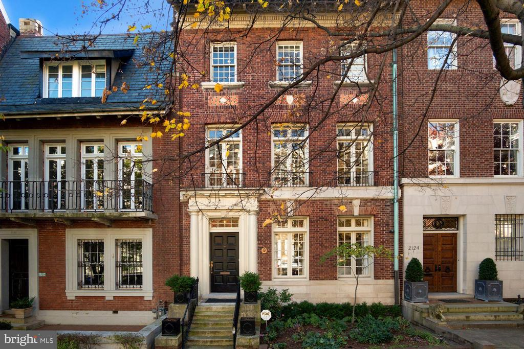 Extraordinary Kalorama Townhouse.  Built in 1908, no detail was spared in the renovation and finishes of this historic townhouse.  Grand entertaining spaces with original architectural detail combined with modern living define this home.  Spacious formal living room and dining room lead to the large kitchen and sitting room.  Off the main level of the home resides a large terrace with multiple seating areas and an outdoor kitchen.  On the second floor a stunning  library with wood burning fireplace.  Additionally a large main bedroom suite with two walk in closets and an outdoor deck.  A half bath has been added to assist with entertaining.  On the upper floor, three additional bedrooms, including one presently used as a spacious hime office with gas fireplace, two full baths and a large deck.  On the roof is a large deck with panoramic views of Washington and Virginia.  Multiple seating spaces allow for a large gathering for viewing fireworks on the 4th of July on the National Mall.  In the lower level, a large one bedroom in-law suite with outdoor terrace, a gym, wine storage and utility room.  Additionally a large two car garage with access from the main house walkway and alley.  Steps to the White House, restaurants and downtown.