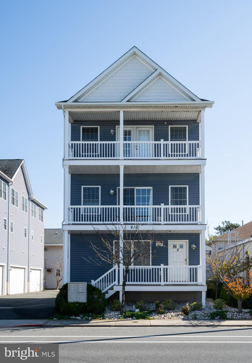 Price Reduced by $40,000.  Spacious single family home located just blocks from Ocean City, Maryland's Famous Boardwalk and Beach. This 3 story home features a bright and open floor plan with vaulted ceilings, two master suites, and multi-level decking. Relax by the South Island Villas community pool as this complex has only 5 units. There is plenty of room for your vehicles with a 2 car rear entry garage, along with off-street parking. Enjoy two free fishing piers, as well as the Downtown Recreation Complex along the bay where you find a ballfield, playground, basketball courts, tennis courts, and the Ocean Bowl Skate Park. Restaurants, shopping, amusements, and the White Marlin Open fishing tournament are all within a short distance. This home has never been rented. The projected rental income is $40,000 + per year.