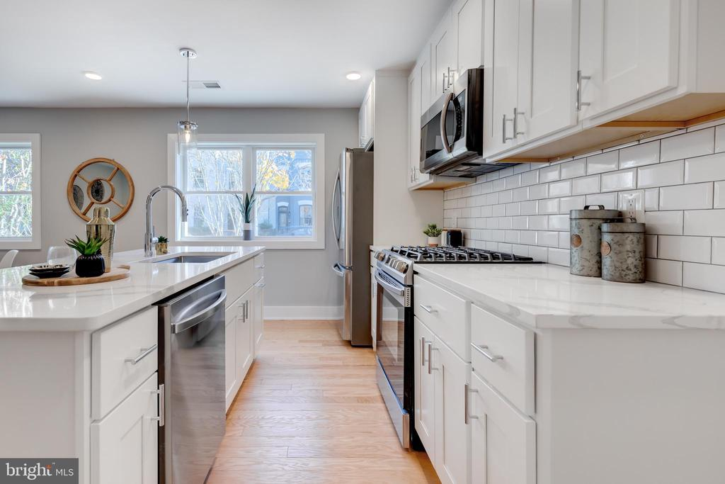 *** $2000 WHEN USING PREFERRED TITLE COMPANY & LENDER*** ***UPGRADE TRIM PACKAGES AVAILABLE TO INCLUDE, WALL ACCENT MOLDINGS, ACCENT COLOR WALLS, SHIPLAP - INQUIRE WITH AGENT FOR FURTHER DETAILS***  5 UNITS REMAINING -- H Street's newest boutique condo building by 202 Development! 714 Eleventh Condominium provides (12) thoughtfully designed one and two bedroom units with four different floor plan options. Unit 201 exudes a luminous open concept kitchen with white shaker cabinetry, quartz surfaces, crisp subway tile backsplashes and stainless steel appliances. White oak flooring is found throughout alongside striking chrome hardware and fixtures. The bathroom includes a large vanity with under counter storage, soaking tub, subway tile surround, and shower niche. Each unit provides modular Elfa closet systems that can be adapted and adjusted to the owner's evolving storage needs. The building has been outfitted with  energy efficient windows, insulation, and extensive soundproofing. The dining, nightlife and shopping amenities of H street are less than one block away and Whole Foods is an eight minute walk from the building. The free DC Streetcar stop is two blocks from the property and provides an easy 8 minute ride to the Metro (Red) and Amtrak trains at Union Station.