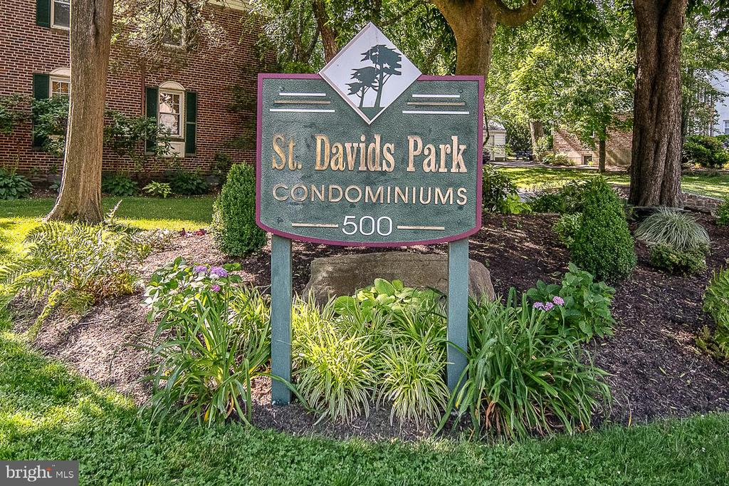 Enjoy easy living in this wonderful walk to Wayne location offered by this beautifully renovated and maintained second floor condo at St Davids Park in Wayne. The bright, open floor plan has windows with a view of the outdoors in every room and a nice size living and dining room. The gourmet kitchen, open to the living spaces, has been completely remodeled and boasts beautiful semi-custom cabinetry that was designed to maximize storage, stainless steel appliances and granite countertops. A bar height granite counter is great for both entertaining and casual dining. The bedroom has generous closet space that has been enhanced by a custom closet organizing system. The bath was completely remodeled and has a soaking tub with shower and large vanity that offers ample storage as well as a linen closet. Additional closet space can be found in the entryway coat closet and hallway closet. This unit has lovely refinished hardwood floors and newer windows throughout. This condo also enjoys a heated private lower level bonus room that houses the full size washer, dryer and laundry tub. It is approximately 16 x 18 ft and can have multiple uses such as a home office, exercise room, craft room or just excellent storage space. Also included is a hard-to-find garage space (separate Tax ID# 36-03-01702-56), which is a very short walk from the condo. Low, low taxes, a condo fee of $217/month and its move-in condition makes this unit a terrific deal. Easy walk to downtown Wayne for dining and entertainment and to the St Davids Train Station as well as essential shopping (grocery store, pharmacy, banks, gas station, hardware store). Minutes from abundant shopping opportunities, Rt 476 and the Radnor Trail.