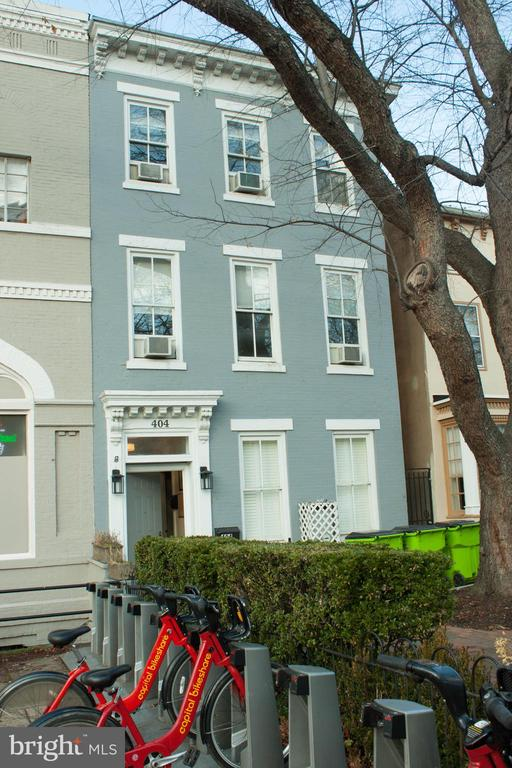 "Fabulous location. Just 4 blocks to the US Capitol Complex,  plus a block or two more to Senate and/or House office buildings and the metro (orange and blue lines on House side and red line at Union Station  on the Senate side).  This is truly a centrally located home to everything the Hill has to offer!    And just a few blocks further to Eastern Market and all its shops, amenities, restaurants, and public swimming pool. This well situated home has high ceilings throughout and is ready for your own personal updates, or for use as an AirBnB. There are multiple bedrooms, baths and kitchens. This home could be easily be converted  back to a wonderful single-family dwelling.  Just whatever works  for you --the potential is unlimited! See this today !!   Sold  ""as is""."