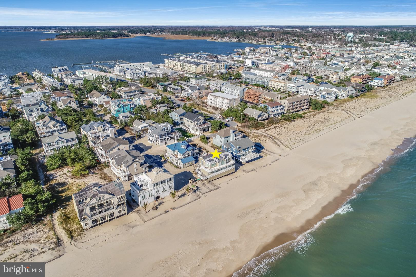 Now is your chance to own 1 Beach Avenue - One of the most highly coveted addresses along the East Coast. This oceanfront property is situated on one of Coastal Delaware's most unique lots. With no dunes to block its ocean views, you can walk directly out your front door and onto private North Indian Beach. Enjoy expansive vistas of the Atlantic from multiple outdoor decks, including two new rooftop decks. The inverted floor plan maximizes the panoramic beauty of these ocean views. The first level offers 5 bedrooms, 4 full bathrooms, and a large laundry room. Second-level highlights include a large kitchen, open living and dining areas, a powder room, and a sixth bedroom with a full bathroom. This bedroom could also be used as a second living area, den, or study. This home boasts a brand-new architectural shingle roof as well as new HardiePlank siding. Additionally, the eastern side of the home has new Pella 350 Series windows and doors with AZEK framing. Store your boat across the street from your home at the Rehoboth Bay Marina. North Indian Beach is a small, unique community with a private, guarded beach and private security. Located on the southern end of Dewey Beach, it also offers an easy walk to a variety of resort-style amenities. Easily stroll into town for a night at the Starboard or Rusty Rudder; or, ride your bike or take the trolley into downtown Rehoboth Beach. Flood insurance is currently under $5K per year and is transferrable. This home is priced competitively. Call for your own private tour today!