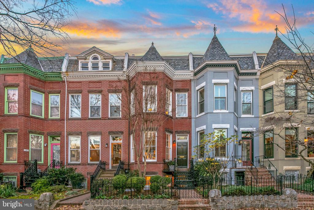 Look no further! This stunning all brick rowhome is located on one of the most coveted streets in Historic Capitol Hill and literally steps to Lincoln Park! This home features 5 bedrooms and 2.5 bathrooms, a deep, private, newly landscaped front/backyard with a patio that faces a lovely shelled grotto with fountain that leads to the carriage house/oversized one-car garage, including your own private driveway! This home was originally designed by DC Architect Robert Bell (https://www.robertbellarchitects.com) and includes 3 levels of living space IN ADDITION TO a separate fully remodeled  English basement apartment/in-law suite that includes 2 bedrooms, kitchen, living room with a private front entrance.  The home is Zoned RF-1. Coming through the front door you enter into the large bright open living room with a gorgeous framed wood burning fireplace, open staircases, soaring 30 ft ceilings that include custom-designed cutouts & skylights to allow natural light from every direction. This unique and custom home is unlike anything on the market with all the character and charm of Historic Capitol Hill. The dining room has French doors with a Juliette balcony that could easily transform to an outdoor deck and leads to the backyard that boasts established foliage including an old growth Japanese Maple tree, fragrant climbing roses and Westeria blooming all over the property. The lower level is perfect for short or long time guests/extended family with a large entertaining area, newly renovated kitchen, full bath & 2 bedrooms with ample closet space. Second level offers 3 bedrooms and an unexpected fourth level loft that could be used as an extension of the master bedroom, office or sitting area that leads to the rooftop where you can actually see the fireworks. Roof is only a few years old, HVAC systems are also newer, so this home is MOVE-IN ready with a ton of potential to add your mark on it. All of this just a short half mile walk to Eastern Market with all its amen