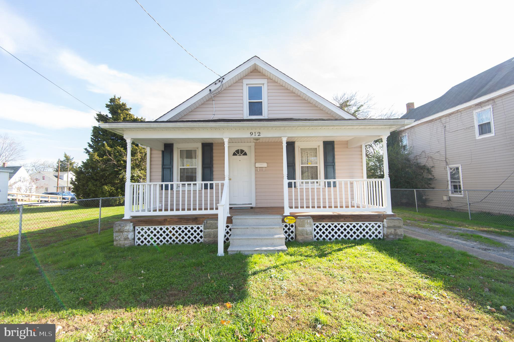 Updated and affordable! Charming 3 BR, 1 BA Cambridge bungalow. Upgrades include replacement windows, recent roof and siding.  Central AC/heat pump.  You will enjoy  the front  porch and back deck. Rear yard is completely fenced.  Off street parking.