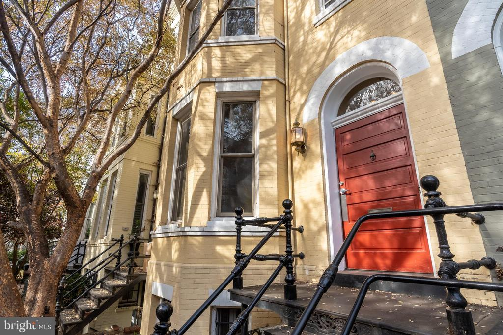 Like a majority of the houses in the Dupont Circle Historic District, this turn-of-the-century Victorian bay front rowhouse was originally built for middle class professionals and official Washingtonians.  With a 20+ year old renovation that maintained much of its original floor plan and architectural details, this home offers its new owners the ability to occupy immediately and update over time. High ceilings, original hardwood floors and multiple fireplaces are just a few of the features offered by this magnificent home that is just a short walk to Metro, the stores in the West End or the ever-popular Farmer's Market at Dupont Circle.