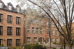 4500 SQUARE FEET OF SUNSHINE AND A BIT OF PROVENCE IN THE CITY- 24/7 SECURITY, ELEVATOR AND 2 CAR GARAGE PARKING!    RESIDENCE IS NOW VACANT AND MOVE -IN READY!   IMMEDIATE POSSESSION POSSIBLE!  A stunning top-to-bottom renovation by a renown international designer!  This light-filled townhome has 5 bedrooms, 5 and a half baths and an elevator to all floors.  The foyer and stairwell to the first floor and lower level entry is papered with a Manuel Canovas design and the stair runners are wool sisal imported from London, England. The gourmet kitchen has top-of-the-line appliances, custom cabinetry and adjoins to a sunny breakfast room. The first level is complete with a large living and dining space in the rear of the house that walks out into a serene, private garden. The second level with living room, library, powder room, and butler's pantry provides additional room for living and entertaining. The master suite occupies the entire third level and has a spacious bedroom with sitting area, dressing room (or second bedroom), and two full baths. The top level of the home has two ample-sized bedrooms, both with en-suite baths. All bathrooms have been renovated with marble tile floors, marble tile showers and countertops.  Bathroom fixtures are high-end Kohler products, with custom-made mirrored recessed vanity cabinets. There are hardwood floors throughout the residence and a central vacuum system.  On the lower level there is a fifth bedroom, full bath, laundry, storage, and entry that leads to the two large parking spots in the garage. The home is located in Kalorama Square which is a private, gated community with 24/7 security and an outdoor pool.