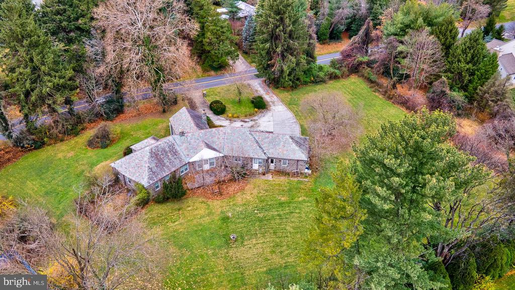 Immeasurable opportunity to restore this lovely stone home to its original stature, or to sub-divide the land into 2 parcels and develop them.  The existing home is fronted by a semi-circular driveway on 1.28 picturesque acres in one of the best locations on the Main Line.  In fact, one of the best and most notable features is the location: a 5-minute walk to Whole Foods, many other shopping locations, as well as the train into Center City and New York.  Don't miss this rare chance to recreate or build the home you've envisioned.