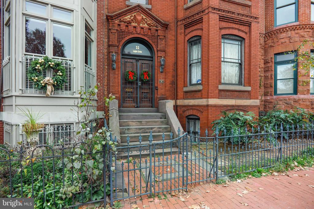 This is a once in a lifetime opportunity to own a home on the most beautiful residential circle in DC.  23 Logan Circle, NW is one of the rare remaining single-family historic homes on Logan Circle.  The house retains many of its original features and much of its character combined with judicious updates.   The twenty-five-foot frontage with its wide bay window offers a look into the popular urban oasis that Logan Circle has become.    Built in 1883, the house was designed for grand entertaining with the elegance and grace of the period.  Among the architectural features are multiple fireplaces and a sweeping three-story mahogany and oak paneled staircase.   The main floor has double parlors with eleven-foot ceilings, working pocket doors, magnificent moldings, ceiling medallions and wood floors.  The full formal dining room, also with high ceilings and detail, leads to an enormous kitchen with den or family room adjacent.    There are four bedrooms and three full baths on the second  floor.  The larger bedrooms can easily accomodate Victorian furniture.  The third floor has two bedrooms, one full bath and a kitchenette.   The full, unfinished basement contains the laundry area and a full bath, in addition to several rooms available for storage or renovation.  There is a rear yard with a deck and off-street parking.  23 Logan Circle NW lived the last years of its life as the Chester A. Arthur Guest House.  Although President Arthur never stayed there, as far as is known, the house was built during his brief term for his Under Secretary of the Treasury.   The bed and breakfast generated high marks from Trip Advisor for its charm as well as its location.  The house is ideally situated at Logan Circle with its plethora of restaurants, shopping and entertainment.  23 Logan Circle, NW,  is just blocks from all Metro lines, is on a bus line and has easy access to major roads.    Walk/Transit/Bike Scores are 98/85/99.  Logan Circle has been described by National Geographic