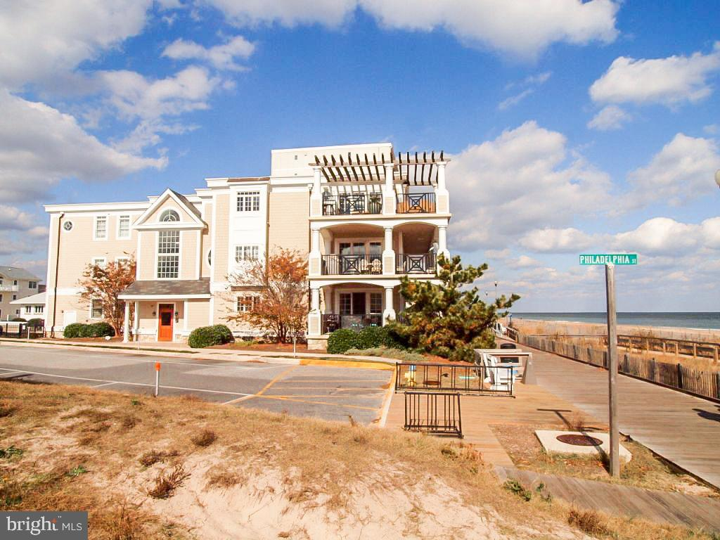 Oceanfront condo encompassing entire 2nd floor with 4 magnificent suites including huge master suite with luxurious master bath and walk-in closets.  Large covered wrap-around balcony with panoramic views of beach, ocean and boardwalk.  Custom built including gourmet kitchen, private entrance by elevator or stairs to 2nd floor.