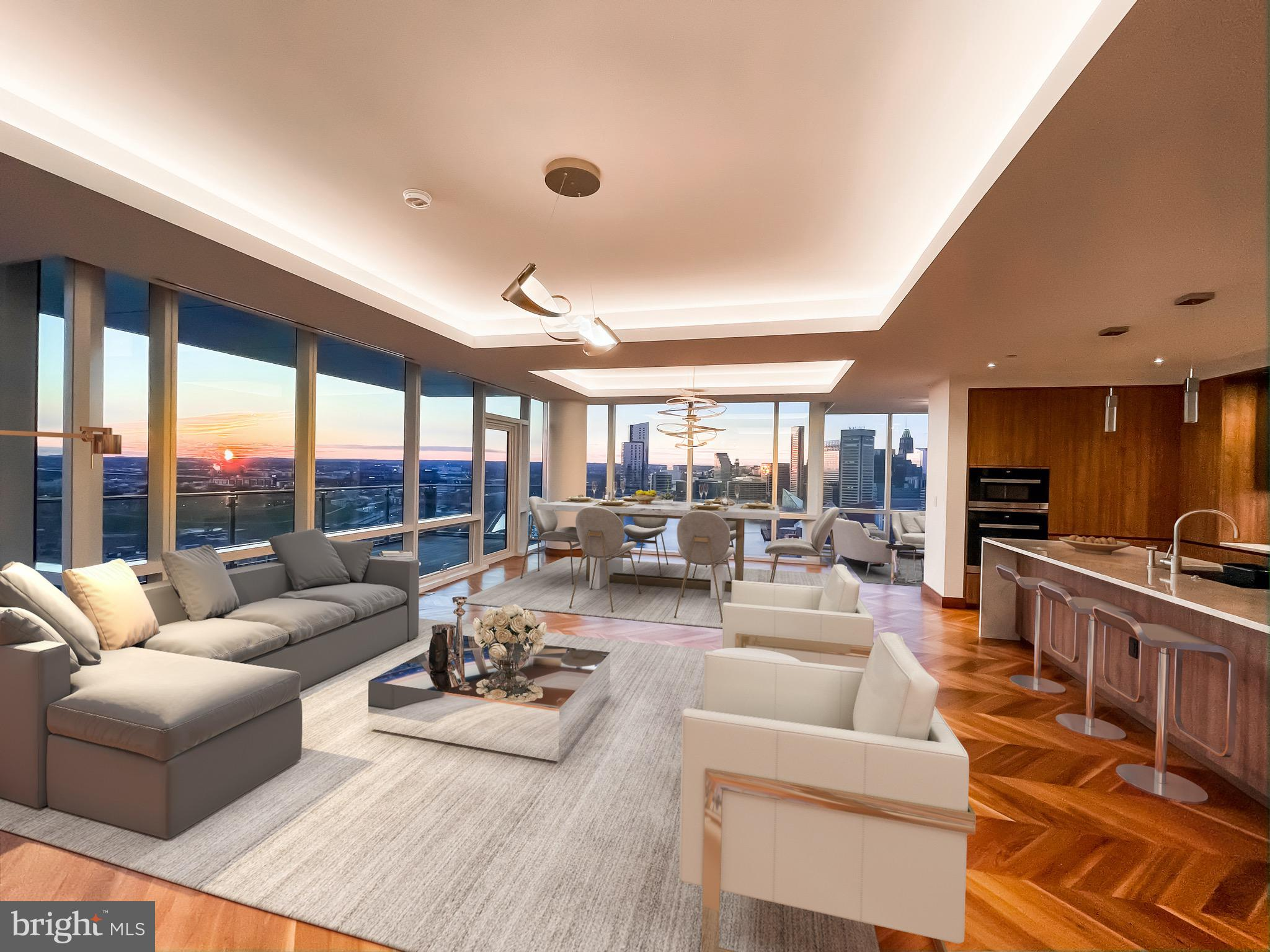 "Incredibly rare opportunity to own one of only three ""A"" model floorpans in the Four Seasons.  These residences were the first to sell out - and for good reason !!  They have the most spectacular panoramic view not only in the building - but along Baltimore's Inner Harbor.  3042 sq ft (interior) of the most luxurious living Baltimore has to offer.  Floor to ceiling windows (glass walls) with views of Canton (and beyond) Locus Point, Federal Hill, The Inner Harbor and even Camden Yards and Raven Stadium.  This is a spectacular 3 Bedroom, 2.5 Bath residence on 20th floor.  The open floorplan accommodates today's luxury urban homebuyer including a custom gourmet Kitchen with Miele appliances & marble waterfall counters and backsplashes open to a magnificent Living Room / Dining Room comb plus a family room.  All with spectacular waterfront views. The sumptuous Master Suite with Dressing Room & marble Bath faces south for all day sunshine.   Rounding out this inviting floorplan is the dedicated media room. Chevron walnut floors throughout, exceptional custom finishes & lighting and a  23-foot Ipe hardwood Deck with sweeping Inner Harbor views out to the Key Bridge. Residents only amenities include indoor pool & sauna, conference room, fitness center & community center with 2 lounges, billiard area, fireplace, kitchen, dining area & 2 large balcony decks. Outdoor amenities include wraparound roof decks including sun deck, cooking center with gas grill, outdoor fireplace & fenced dog park. 2 separately deeded premium garage spaces, and additional storage.Luxury living at its finest in Baltimore's premier full service building!"