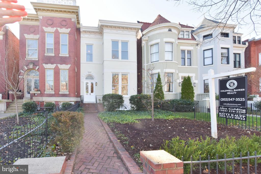 Price Improved! Capitol Hill Elegance! Rarely available c. 1896 large semi-detached Victorian Townhome 3b/3ba Main House (3,516 SF) featuring enormous lot (2,392SF), separately metered Lower-Level Rental Unit 2bd/1ba ($2,245/Month) with Certificate of Occupancy. Connecting interior stair between main unit and lower level allow for versatility of use e.g. home office, playroom or keep as separate rental unit! One-car garage in rear.   Original details abound in this high ceiling (11ft), traditional Capitol Hill gem.  2 fireplaces punctuate the well-pointed and stately rooms. House is detached on West side, allowing for windows on all 3 sides of building – a rare benefit on the Hill! In front, large oversized Victorian windows on both floors allow light to flood the front rooms.  Spacious eat-in Kitchen/Family Room with direct access to yard provides excellent indoor-outdoor space.   Deep front yard with formal landscaping provides a gracious entry to the House. Side-passage leading to backyard is great for flow and entertaining in the rear. Backyard features large porch and ample space, perfect for a garden-party or entertaining/ play.  BONUS  ONE CAR  DETACHED GARAGE IN REAR!