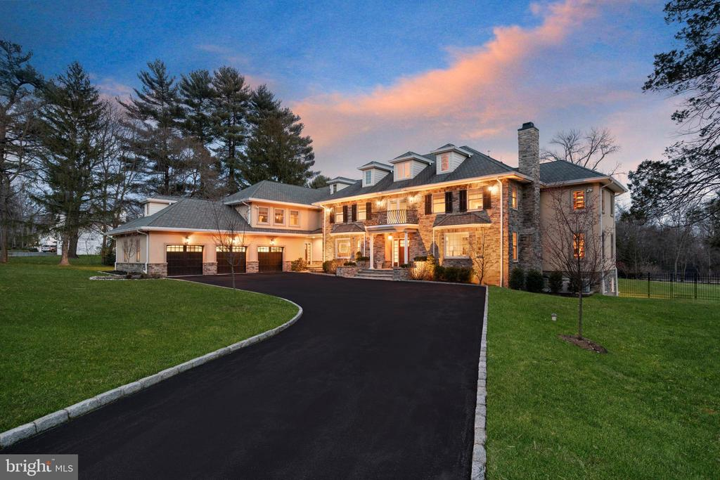 Stately, NEWER STONE MANOR HOME with INCREDIBLE CURB APPEAL in the Merion Golf Neighborhood in Haverford.  Beautifully sited on a 1.2 +/- professionally landscaped and fenced acres, this property takes full advantage of its Southern exposure to offer SUNLIGHT THROUGHOUT THE DAY in a serene, natural setting with complete privacy.  This 10,000+ square foot home is truly unique graciously scaled rooms, 10+ft ceiling heights on four levels, a sun-drenched interior, transverse floor-plan, and an incredible flow make this perfect for comfortable FAMILY LIVING AND GRAND SCALE ENTERTAINING. Luxuriant details are present inside and out, including: handsome stone facade, numerous walls of windows drenching the interior with sun, soaring ceilings, tall doors and arched doorways, extensive crown molding and wainscoting, deep-silled windows, gleaming site finished hardwood floors,        designer-sourced fixtures, and imported marbles and granites.  Access this 3-STORY MASTERPIECE of 6+ BEDROOMS and 7-1/2 BATHS via lit stone piers and a Belgium block lined drive.  Elegant flagstone stairs and a columned portico lead you into a grand 2-story entrance hall with beautiful flared staircase and windowed landing. Off the entrance hall are a formal living room with marble gas fireplace and built-ins and a large formal dining room with adjoining butler's pantry.   A large, custom painted paneled library with beamed ceiling and built-in bookshelves creates an incredible work-at-home environment for even the most discerning professional. The sun-drenched family room with vaulted ceiling and limestone gas fireplace comfortably opens to the kitchen, enhancing its role as a central gathering place for family and friends. Living is made easy with a chef's dream kitchen in vintage white maple cabinetry and all Viking professional appliances suited to making any meal; the kitchen is further enriched by an open breakfast area, walk-in pantry closet and access to the extensive outdoor terrace with central line-fed gas grill and hot tub. Rounding out the First Floor is a generous family entrance containing a second office (or potential in-law / au pair suite), bathroom with full-sized stone shower, laundry room with utility sink, and walk-in mudroom closet with built-in bench and shelves.  Ascend to the Second Floor via the central or back stairs to access five ensuite family bedrooms. The oversized master suite contains a sitting area and separate dressing room with built-ins and custom his / her walk-in closets. The sumptuous master bath is outfitted with spa-like carrara marble, dual sinks, deep jetted tub, stall shower with multiple shower heads, and separately enclosed water closet. Completing this floor are four additional large ensuite bedrooms, each with walk-in or generous closet space, and a large laundry room. A third floor offers a bonus room or potential sixth bedroom.  Stay fit and entertained in the amazing walk-out lower level containing tall ceilings, media and game rooms, built-in bar, mirrored gym and full bath, yet still with plenty of unfinished storage space. This elegant home is made simple through Control4 and Vantage smart home technology, enabling app-based control of media, music, security system and cameras, and lighting. A whole-house generator with automatic transfer switch ensures you can weather any storm without loss of comfort.