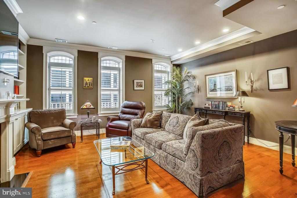 Home should always feel luxurious. From the minute you walk in, you should be surrounded by details that stand out. 1830 Jefferson Place NW #11 defines what it means to live in luxury.  With over 1800 sqft this 2 bedroom, 2.5 bath condo has beautiful details at every turn--tall ceilings, deep crown molding, big windows, hardwood floors, custom cabinetry, and built-ins and more. Those details begin at the front door through the entry to a custom kitchen with rich cabinetry, tin backsplash, Viking Professional appliances, and granite countertops. Turning into the vast dining room you are enveloped by a tray ceiling with exquisite crown molding. It's the perfect place for The Palm, right next door, to bring in dinner for family, colleagues, or friends gathering for a meal and drinks. Off the dining area is the large den with  10 ft ceilings encased by three ceiling-height windows, custom built-ins, and a fireplace surround. Upstairs the spacious master is framed by big windows, architectural angles, and built-ins enveloping the mantle. Two big closets (one a walk-in) hold any wardrobe. The en-suite bathroom is adorned with a neutral palette, double vanity, stand-up shower, large soaking tub, and separate private toilet room. Down the hallway, that is designed to showcase photos or your art collection, you will find centrally located laundry. At the end of the hall is a large second bedroom complete with a spacious closet and a private en-suite bath with plenty of storage. If accessibility is a luxury amenity for you, this boutique building with a rooftop deck and small gym, your own dedicated garage parking space, and superior location bring convenience right to your doorstep. Located on the south side of Dupont Circle, walk to downtown, the White House, World Bank, IMF and more. Have the Palm cater dinner or pick up Surfside for a quick mid-week meal. Take a quick stroll to the new Tatte for coffee. Jump on multiple Metro bus lines or the Red Line easily. 1830 Jefferson Pl NW #11 offers luxury, convenience, and a beautiful place to call home.