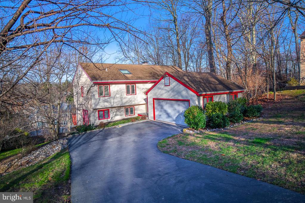 Don't miss this opportunity to live in the sought after Indian Creek neighborhood of Wynnewood.  This sun-filled 3 bedroom, 2 and a half bath, 2,274 square foot home features an open floor plan and beautiful views of the serene .52 acre lot.  Step up into the 2-story living room with floor to ceiling stone, wood burning fireplace, skylights and wall of sliders to the back deck perfect for enjoying your morning coffee and book.  Entertaining is made easy as the living room opens directly to the formal dining area and kitchen with island and tons of counterspace which continues into the breakfast room.  An office/den, half bath and laundry area complete this level.  On the lower level is the spacious walk-out family room, full of possibilities that offers storage space as well as a cedar closet.  Up the stairs to the second floor you are greeted by the gorgeous views of the backyard and living room below from the open hallway.  Here you will find the main bedroom with walk-in closet, linen closet and large ensuite with double vanity, jacuzzi tub and shower.  Down the hall are two additional bedrooms with shared full bath.  2 car garage.  Award-winning Lower Merion Schools.  Close to public transportation, shops and restaurants!  Make this home your own today!