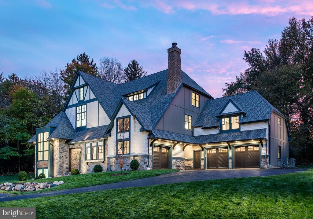 Classic Tudor architecture reimagined with abundant natural light, dynamic new floor plan, set on a 1.6 acre site on an iconic street in Haverford. Built by Mark Weiss, this 5 Bedrooms/4 Full Baths/2 Half Baths home offers a total of 6,673 finished square feet with partially finished lower level plumbed for bath, and 1340 square feet of unfinished attic space with plumbed for a bath. Ten Foot Ceilings on the first floor and nine foot ceilings on the second floor. The Kitchen, Dining, and Family Rooms have been drawn together to create a dramatic, livable space that encourages family gatherings and entertaining.   Abundant and oversized windows throughout.