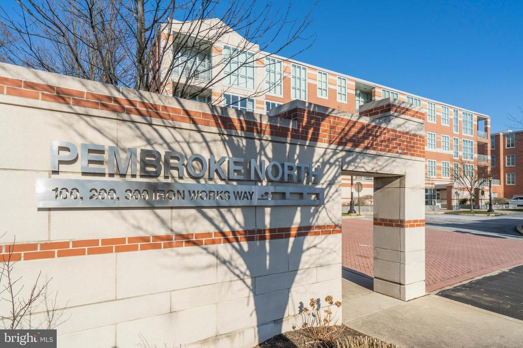 "Welcome home to Pembroke North! This gorgeous building was designed by architect Robert Venturi and offers a luxurious, state of the art, and environmentally friendly building. 326 Iron Works Way is a beautiful light-filled 2 bedroom, 2 bathroom corner unit that is over 1,500 square feet. Located on the second floor of the #300 building, this condominium is quiet and spacious while providing walkability to Wayne. Enter through the front door and you will be greeted by beautiful hardwood floors that span throughout the condominium living spaces. Just past the foyer on your left-hand side is the spacious owner's suite. The owner's suite is complete with plush neutral carpet, two large closets, and ensuite bathroom. The spacious ensuite bathroom features a large walk-in shower with subway tile, an air jetted bathtub with marble surround, and a large vanity with dual sinks. Just across from the owner's suite you will find the laundry area that houses the mechanicals as well as built-in storage. Making your way down the hallway you will approach the hall bath on your right-hand side. The hall full bath is finished in neutral colors, houses a shower/tub combo, and also is accessible from the guest bedroom. The guest bedroom offers large windows with abundant natural light, neutral carpeting, and a large closest. This room is currently being used as a study so it offers multiple purposes to the new owner. The kitchen great room area is the perfect space for entertaining with wall to wall windows. The kitchen features white cabinets, granite countertops, stainless steel appliances, subway tile backsplash, a large island with plenty of seating, and an abundance of countertop space. The large combined living and dining area offers a plethora of natural light. Just off the dining area you will find access to the balcony in which you can enjoy the view of flowering trees in the springtime. This sophisticated, luxurious unit feels almost new as it has been professionally designed and immaculately cared for. There is also an in-house parking space in the temperature controlled garage. Pembroke North's LEED Certification and energy-efficiency features (such as the geothermal heating & cooling and tankless gas hot water heaters) help to reduce average monthly utility costs. Pembroke North offers a ""turn-key lifestyle"" in an unparalleled location ! It is close to Wayne's popular shopping, dining, and entertainment destinations as well as two train stations and allows easy access to all major area roadways. Do not wait to call this condo your home!"