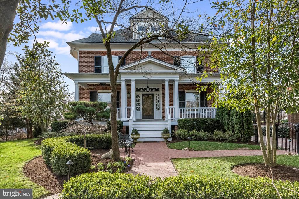 One of the prettiest residences in all of Annapolis. Steps from Spa Creek.....This stunning 4 (Four) Square Georgian Colonial is graced by a charming front porch with handsome columns to welcome you home. Built in 1927, and fully restored in 2013 and finished with the finest materials.  The thoughtful design accomplishes the exquisite home it is today. Gracious entrance, the Veranda spans the front of the home, a historic Annapolis beauty with custom moldings, crown moldings, and beautiful custom light fixtures throughout. The Owners retained the charm of the original home and incorporated modern amenities, high-end finishes, and exquisite decor to accomplish an open floor plan with cozy escapes, all in the coveted neighborhood of Murray Hill in Historic Annapolis. Gourmet kitchen with great workspace.  Family room with coffered ceiling adjoins spacious breakfast area.  First-floor executive office with custom built-ins. 2nd Personal office on the second level. Elegant Owner's suite. Gathering/wine room perfect for gathering friends and neighbors to watch the big game or Netflix series. Well-appointed mirrored Exercise room. Loft/Game room with Spa Creek rooftop deck views are the perfect spot to enjoy vistas of Eastport Christmas Boat parade and yachting activities on Spa Creek. Outdoor relaxing and entertaining options abound in this gracefully appointed home. Fenced yard. Back-yard stone patio boasts an electric awning well fitted for multi-seasonal alfresco dining and entertaining.  Detached 2 car garage with unfinished space above. Great walking neighborhood - stroll to Murray Hill's waterfront parks, arts, museums, Naval Academy, restaurants and shopping. Short walk to Spa Creek... launch your kayak, canoe, or catch a ride into town on the Water taxi. Come and enjoy the Annapolis lifestyle from this outstanding home.