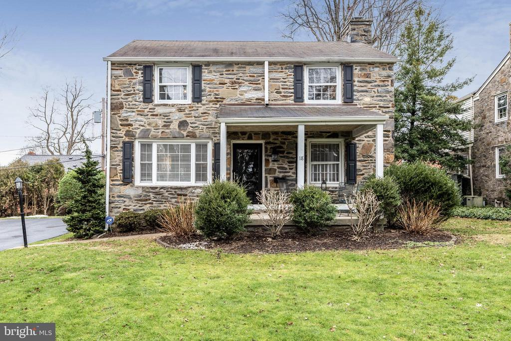 Beautifully updated stone colonial in Radnor Township situated in popular Old Oaks neighborhood.   A delightful front porch greets you as you enter.  Current owners had the wall that divides the kitchen and dining room taken down to create a bright and open floor plan.  The new gourmet kitchen boasts custom cabinetry, quartz countertops and an extra large quartz island with plenty of seating and accent light fixtures from Anthropologie.  GE stainless steel appliances and an LG refrigerator with 2 freezers make this the perfect kitchen for families on the go!  Access to the driveway and garage is from the back door located in the kitchen making for easy in and out with groceries and outdoor playtime for the kids.  Powder room is just off of the kitchen.  Original hardwood floors throughout have been recently refinished.  The entire home has been freshly painted in todays popular colors! The deep window sills add to the charm and character of this home with its integrity still in tact.  All new windows on the first floor.  The large living room has crown molding and a wood burning fireplace.  The second floor has 3 bedrooms and a large hall bath that was recently renovated with a double sink vanity and quartz countertop,  and seamless sliding shower door.  Large master bedroom with plenty of closet space.  All closets have been customized to meet the needs of a growing family.  Finished basement with laundry perfect as playroom, extra living room or office.   An attached 1-car garage with driveway and a level rear yard.  New hot water heater, newer furnace and central A/C.  All of this within walking distance of the R5 Septa train that will take you into Philadelphia in just minutes or connect at 30th Street Station where you can catch a direct train to NYC.  A short walk away is the R100 Speed Line along with various parks and playgrounds.  Within minutes you are in the heart of the main shopping and dining districts of both Bryn Mawr and Wayne.  The Radnor Trail is 