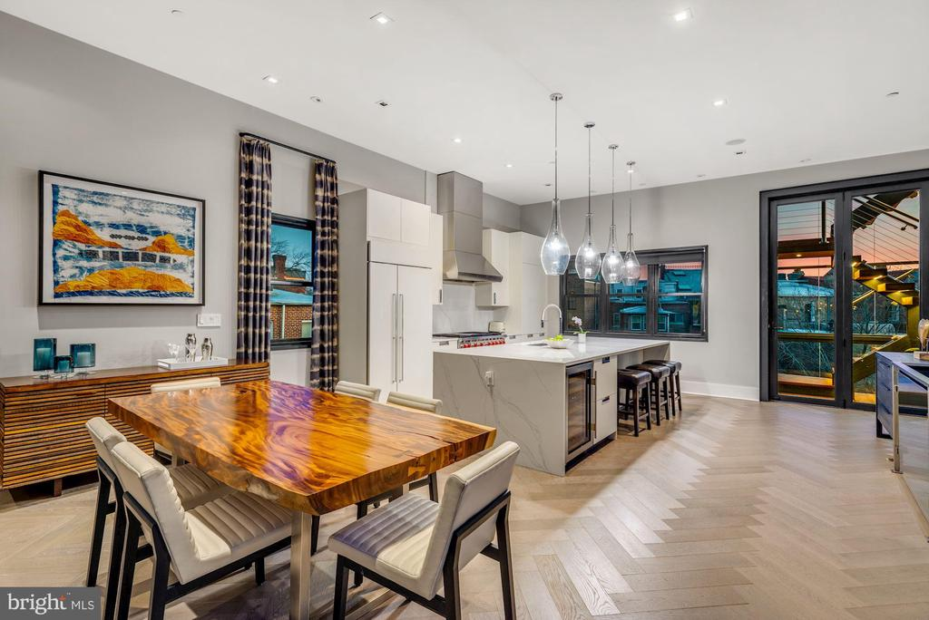 "OPEN HOUSE:  WED (yes Wednesday!) MARCH 3, 11AM-12:30PM -- have your Agent schedule your visit so we can minimize overlapping groups!  All the space of a luxury modern townhome. All the turnkey features of a boutique condo. A rare find --- Spectacular, sun-splashed 3BR+Family Room/3.5BA with pretty Monument views and city vistas from Private ROOFTOP Terrace (approx 800 sq ft). Enjoy direct access via ELEVATOR and two-car GARAGE PARKING.  Best of all worlds --- lives like a spacious modern rowhome with the turnkey convenience, views and natural light of a penthouse condo. Superb  Logan locale with a WalkScore = 98 ""walker's paradise"". Breath-taking ""stairway to heaven"" makes this stand out in the crowd!   Stunning open floorplan on MAIN LEVEL features gracious Entry, spacious Living Room area with custom gas Fireplace open to Dining Room. Sleek gourmet Kitchen completes every buyers' wish list with waterfall Island with plenty of seating and fully equipped with s/s appliances including SubZero fridge, Wolf gas range, Bosch dishwasher, built-in microwave drawer, and wine fridge. Discreetly located and nicely appointed Powder Room.  Beautifully re-imagined glass-enclosed stairway to Private Rooftop with sliding door access -- true architectural genius.   An extraordinary urban oasis awaits on the private ROOFTOP TERRACE no matter the season. Wonderfully outfitted for open air entertaining! Large custom island with seating, spacious layout with room for a fire pit and a multiple seating arrangements, builtin gas grill, sink and ample cabinet storage. Over-sized planters offer additional privacy.  Custom sail cloth shades make it perfection on a sunny day.  BEDROOM LEVEL offers luxe Homeowners Suite with fully customized walk-in closet, additional step-in closet, with additional space for office nook or sitting area and attached spa-like bathroom with dual sink vanity, frameless glass shower, stand alone tub and gorgeous floor tile. Second Bedroom with large closet and attached full Bathroom. Third Bedroom with enviable customize walk-in closet located next to hall Full Bathroom. Versatile Family Room offers bonus space. Laundry Area and additional storage also located on this level.    DESIGN NOTES:  Gorgeous wideplank hardwood floors; 10' and 12' ceiling height, 9' doors; Floor-to-ceiling windows with automated custom window shades  Ideally located nearby the best of Logan and the 14th St Corridor. Showings by appointment only with notice."