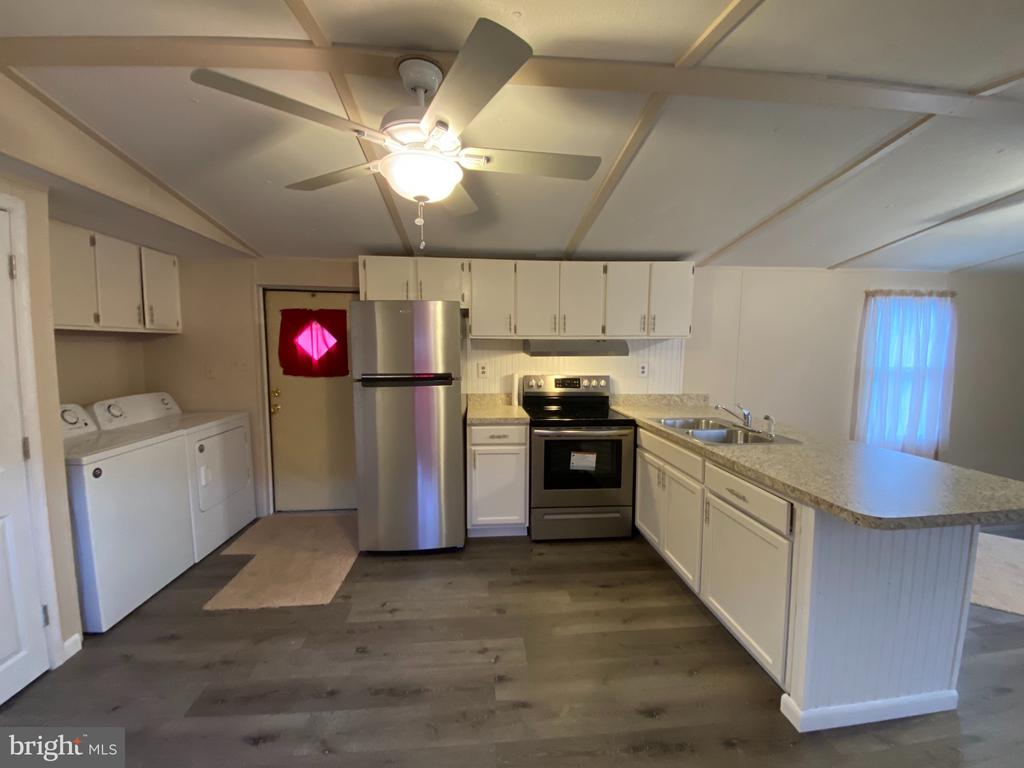 Freshly remodeled Mobile Home.  New Carpet and Vinyl flooring throughout.  New Heat Pump and Central Air Unit.  New Washer, Dryer, stove and refrigerator in Kitchen.  Privacy fence and brick patio area in rear.