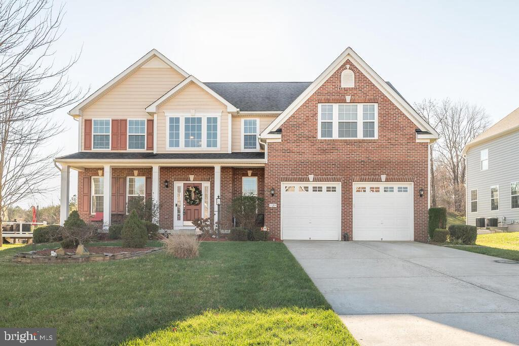 Gorgeous brick front Colonial in Brandywine!  Soaring two story foyer with hardwood floors.  Kitchen with granite counters, 42 inch cabinets, pantry and gas range!  Morning room with exit to composite deck.  Living room with crown moulding.  Dining room, family room and powder room also on main level.  Fully finished basement with rec room, full bath, bonus room, exercise room and private exit.  Four bedrooms and two baths on upper level.  Luxury owner suite with sitting room, walk in closet, and attached super bath with dual vanity and soaking tub.  Hall bath with dual vanity and ceramic tile.  Coveted bedroom level laundry.  Tranquil lot backs to woods.   Wrought iron balusters.   Pergola.  Zoned HVAC.  New sump pump.  This home is an absolute MUST SEE!