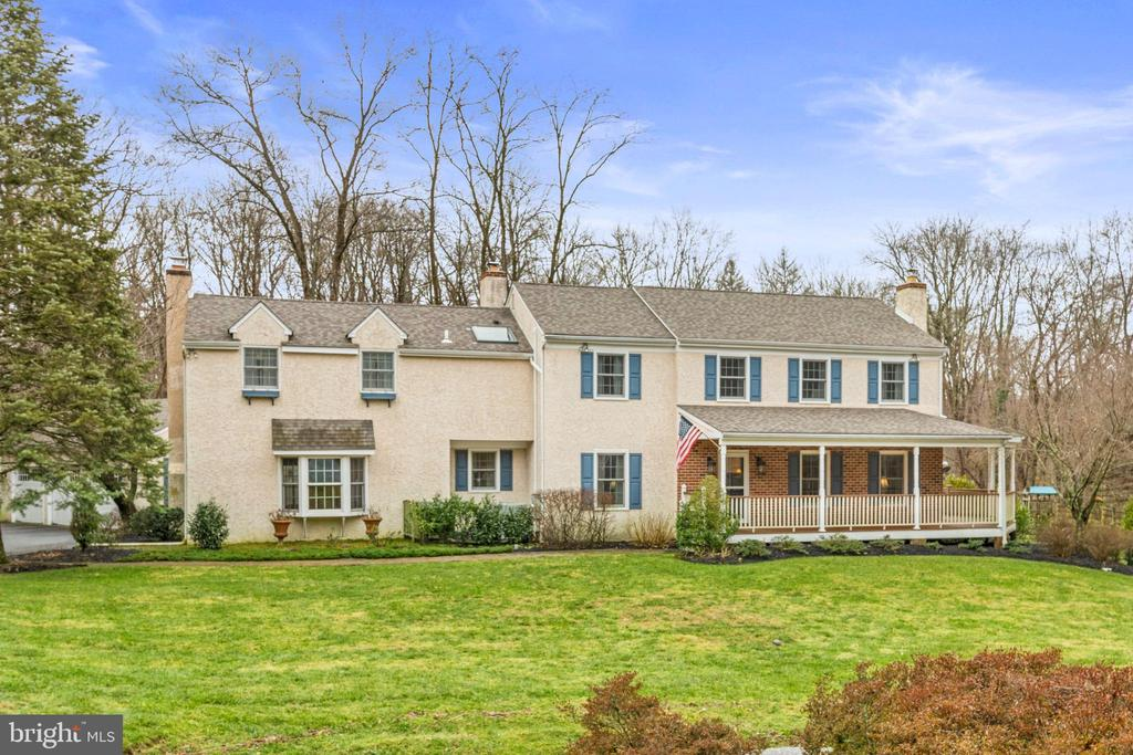 Situated on a spectacular 1.4 acre flat lot at the end of a quiet cul-de-sac in Radnor township, this 5 bedroom, 3.5 bath home offers the best of both worlds: a bucolic, private setting featuring pool and beautiful grounds, and a convenient location near all that the Main Line has to offer. Pride of ownership is evident throughout this exceptionally well maintained home with the current (and sole) owners having invested over time to create a special home that offers modern amenities coupled with grace and charm.  As you enter off the delightful wraparound porch, you'll notice the beautiful hardwood floors throughout the entire home. The traditional center hall layout provides wonderful flow with the gracious formal living room with wood burning fireplace on your right, and a private, home office on your left that's perfect for working from home. The living room opens to the light-filled formal dining room with wainscoting and French door that leads to the deck. From there you enter the traditional kitchen with updated appliances, breakfast bar, plenty of cabinetry and cozy, wood burning fireplace in the eating area. The kitchen opens to the bright family room that features charming beadboard ceiling and an abundance of windows, accented by skylights, that drench the room in natural light and provide breathtaking views of the scenery.  The great room is a wonderful place to gather and features wood burning fireplace, bay window, wet bar, and rear staircase that leads to the second floor.  A powder room finishes off this floor.  The second floor features 5 bedrooms including the master suite with vaulted ceiling,  full bath, 3 closets and private balcony to enjoy your morning coffee.  Two more beautifully updated full baths plus convenient second floor laundry finish off this floor. The finished walkout basement provides plenty of additional living space and features wainscoting, built-in wine storage and access to the pool area. Picture-perfect fenced lot with beautiful pool, surrounded by mature trees and plenty of flat, grassy areas, is what sets this home apart. Multiple outdoor spaces including the maintenance-free deck with awning and patio areas that allow for easy entertaining or simply enjoying the lovely view. 3-car garage with space above plus outdoor shed provide additional storage. New roof (2017), new heat pump (2017), new pool pump (2020) and all windows recently replaced provide peace of mind. Located in top-ranked Radnor School District (Ithan Elementary), and minutes from the Septa Regional Rail, all major commuter highways, Center City, and shopping & restaurants within the charming towns of Bryn Mawr and Wayne. NOTE: Delaware County is conducting a real estate tax reassessment, effective January 1, 2021. Please contact the county assessor's office if you have questions about this process.