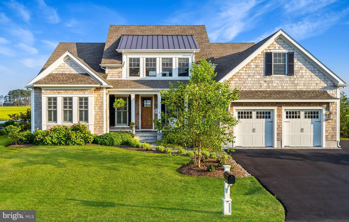 You may have found the sweet spot in this picture-perfect custom-built 4-bedroom home with the feel of laid back elegance. Complete with jaw dropping views of the canal, wetlands and Rehoboth Bay, this home is an entertainers delight with a chefs kitchen, an excellent balance of casual and formal living spaces, a large perfectly positioned screen porch to extend your seasonal entertaining. A patio complete with hot tub, plus a first floor masters suite a spacious office complete the first floor. Travel to the second floor to find a cozy den with access to a large balcony overlooks scenic view, plus three additional bedrooms and baths. They say it is all in the details and that is what you will find here with hardwood flooring, solid wood doors, Sub Zero and Wolf appliances, smart home features and soaring ceilings all wrapped up in a cedar siding exterior. Room for a private swimming pool if desired.