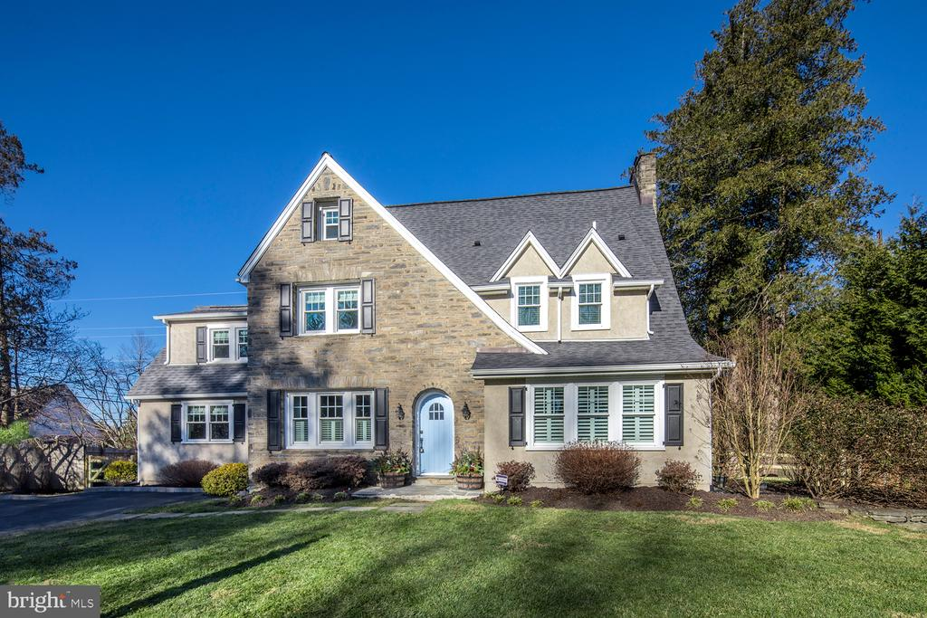 Experience the warmth and elegance of this move-in ready Main Line home in the heart of Villanova! The gracious five bedroom, 4 full + 1 half bathroom Center Hall Colonial sits on a lushly landscaped lot boasting an exquisite stone exterior and abundance of architectural charm. Upon arrival, an arched doorway welcomes you inside to the inviting foyer marked by period tiles and views of the formal living with gas fireplace. Wrapped in stunning woodwork and ample windows, light-filled interiors, gorgeous hardwood floors, stately crown moldings, and spaces to entertain abound!   At the heart of this intimate family residence is a bright and airy chefs kitchen with top-of-the-line appliances, including a new Bosch dishwasher, double ovens, gas range, and expansive quartz island. Nearby, a sunny vaulted breakfast room serves as a great spot for morning coffee or casual dining and leads out to the rear yard. From the step-down family room with heated floors for winter movie watching, to the convenient mudroom with first floor laundry and access outdoors, no detail is left unturned!   Additional highlights include a fabulous sunroom/office with French doors to the side yard, timeless formal dining room with built-ins for making memories at the holidays, and mudroom off the kitchen with convenient laundry. As alluring is the tranquil primary bedroom retreat with a lovely spa-like en-suite bath featuring pedestal sinks, a generous claw-foot tub and separate shower. Also on level two you'll find two bedrooms that share a full bathroom, plus another bedroom and full hall bath. The third floor houses a large carpeted fifth bedroom with a walk-in closet and full bath as well.  Outside, your fully-fenced lawn awaits and is the perfect place for kids to roam and pets to play. Every inch of this classic gem is meticulously cared for and lovingly maintained, affording a rich history of comfortable family living. A newly installed furnace, 80 gallon hot water heater, weatherized fron