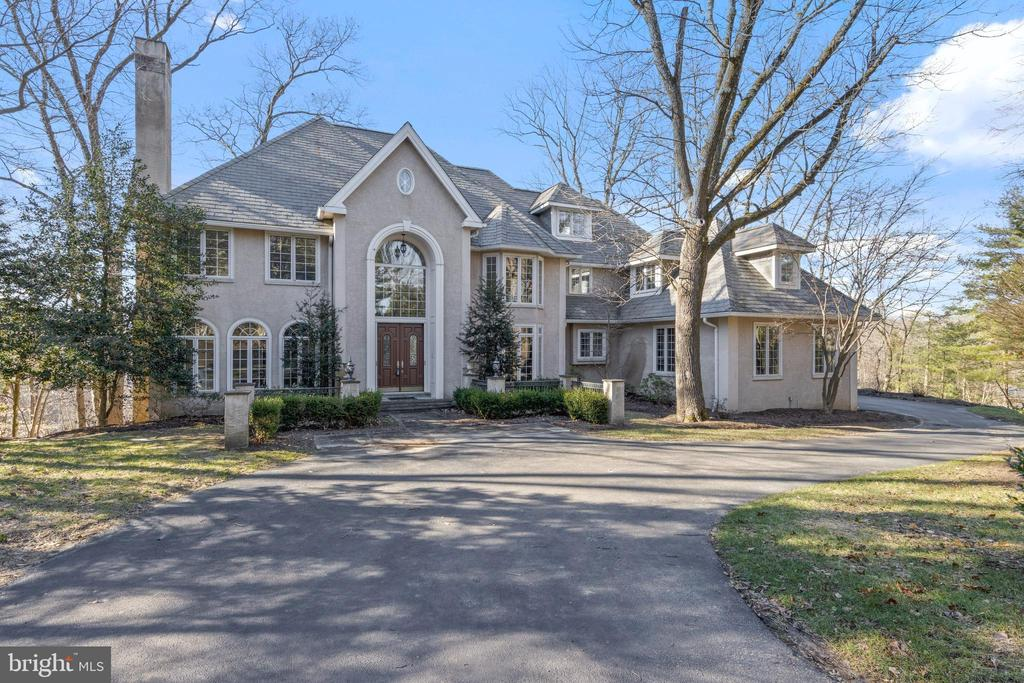"Nestled on a quiet cul-de-sac, down a long driveway for privacy, this magnificent 6+ BD, 5/2 BA French Colonial is one of only 17 custom homes in the quiet enclave of D'Orsay in Devon. Masterfully-built by C.F. Holloway, this estate home features extensive built-ins, gleaming wood floors, stunning windows, enhanced millwork and ample room for comfortably sheltering in place. Marble floors and a graceful curved staircase greet guests in the 2-story Center Entrance Hall. The Living Room is enhanced by intricate carved crown moldings and an impressive fireplace surround. Two built-in china cabinets in the Dining Room provide display and storage for collections and dinnerware. The paneled 1st floor Study features one of 4 fireplaces, and provides quiet space for working from home. A distinctive 2-story stone fireplace, vaulted ceiling, and wall of windows make the Family Room & Breakfast Room enjoyable places for relaxing every day. Gourmet meal prep is easy in the spacious Kitchen, which features abundant cabinet space, large island, granite counters, and gourmet appliances (including 48"" Viking gas cooktop with 4 burners and 24"" griddle, and a 48"" SubZero refrigerator.) The Butlers Pantry with wet bar and beverage frig is centrally located for entertaining. A rarely-found, yet very convenient feature is the separate Sunroom, located just off the Kitchen, which is ideal for Virtual Schooling, another Home Office, or even a perfect place for pets to relax while owners are away.  Upstairs, the expansive Master Suite features a sun-filled Sitting Room, spa-like Bathroom with deluxe double-sided shower, and a huge Dressing Room with walk-in closets, coffee station, and beverage frig. Three more Hall Bedrooms and two more full Bathrooms are located on the 2nd floor. The 3rd floor has a very large TV Room, a 5th Bedroom (currently used for Exercise gear), and a 4th full Bathroom. Downstairs, the daylight Lower Level features a 4th fireplace with stone hearth & surround, walls of windows, a step-up sitting area (or stage for performers!), an Exercise Room, plus 2 more bonus rooms (currently used as Bedrooms 6 & 7) and the 5th full Bathroom. In addition to the large unfinished Utility Room, this home has so many closets, you'll never run out of storage space. Top-ranked Tredyffrin-Easttown School District. Ample room for au pair or in-laws, exercising at home, and extended family visits. Easy access to Devon Yards, the charming village of Wayne, corporate centers, Center City, and the Airport.  D'Orsay even has a private path from within the neighborhood to S. Devon Ave. which facilitates walkability to parks, shopping, restaurants, and the train station. Schedule your private tour today!"