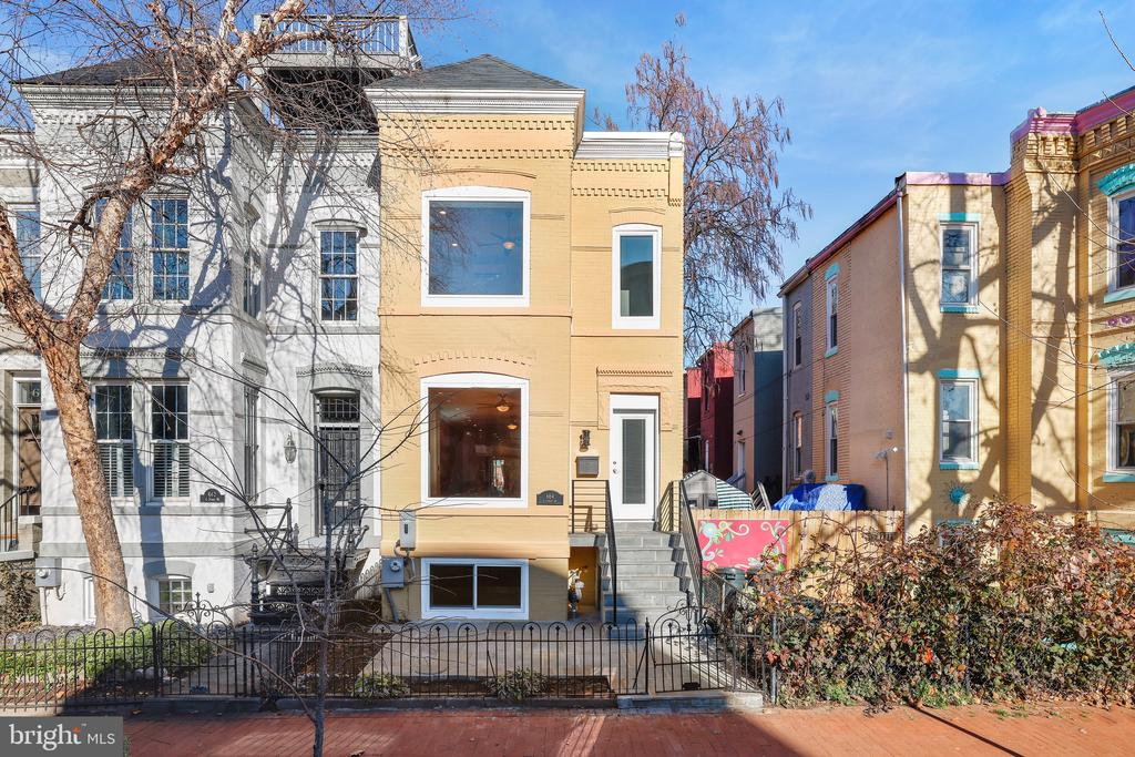 Capitol Hill offers the very best of DC living. Your Buyer will fall in love with this exquisite renovation of a classic brick semi-detached row house. 2900+ sf on 3 sun filled levels with precise attention to every detail and modern amenity. The main level features an inviting open floor plan flooded with natural light, highlighting gleaming hardwood floors. Enjoy spacious living and dining areas, as well as a bright white kitchen with quartz countertops, and top of the line stainless steel gourmet appliances. With an adjacent outdoor living area, a covered deck, patio, and off-street parking. A powder room and closet for storage. Upper level features 3 large bedrooms including an immaculate Owner's suite with spa bath: double vanity, glass-enclosed shower, ample closet (* $2500 allowance offered for the installation of a closet system) plus rear bedroom with balcony overlooking the private back yard, well-appointed hall bath, and convenient laundry area (* 1 of 2). Walk-out lower level offers a large flexible informal living area. Drenched in natural light is a family room, guest bedroom with full bath, kitchenette, 2nd laundry. An additional room can be added. Located in one of DC's most vibrant and eclectic neighborhoods. Imagine your weekend mornings at Eastern Market, a relaxing afternoon at Stanton Park, and a leisurely evening at Union Market or H St. Corridor with its numerous restaurants and performing arts venues. Everything is minutes away. Blocks from Union Staton Metro (Redline), a short drive to access all main roads- 395/695/295/50 & 495, Northern VA & Tyson's Corner, National Harbor & suburban Maryland. This beauty checks all of the boxes. Show and sell today, your clients will love you!