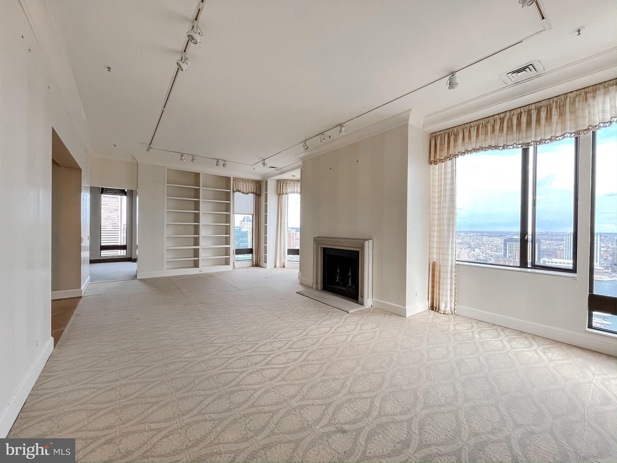 With arguably the best views in all of Baltimore City, this luxury penthouse has incredible vistas of the Inner Harbor from the 29th floor of the Towers at Harbor Court. 12 ft. tall ceilings. 2 bed / 3.5 bath. At nearly 3,000 sq. feet, this unit features an incredibly spacious living room, two wood burning fireplaces, and a master suite with separate dressing rooms and two full baths. 2 assigned parking spaces. Building amenities include 24/7 front desk concierge, uniformed doorman, porters and maintenance staff, guest suite, on-site management, and security. Amenities provided by the attached hotel include a bar/lounge, fitness center, concierge, coffee shop/convenience store.  Property being sold as-is.  Bring your decorator and imagination - price reflects need for updating.